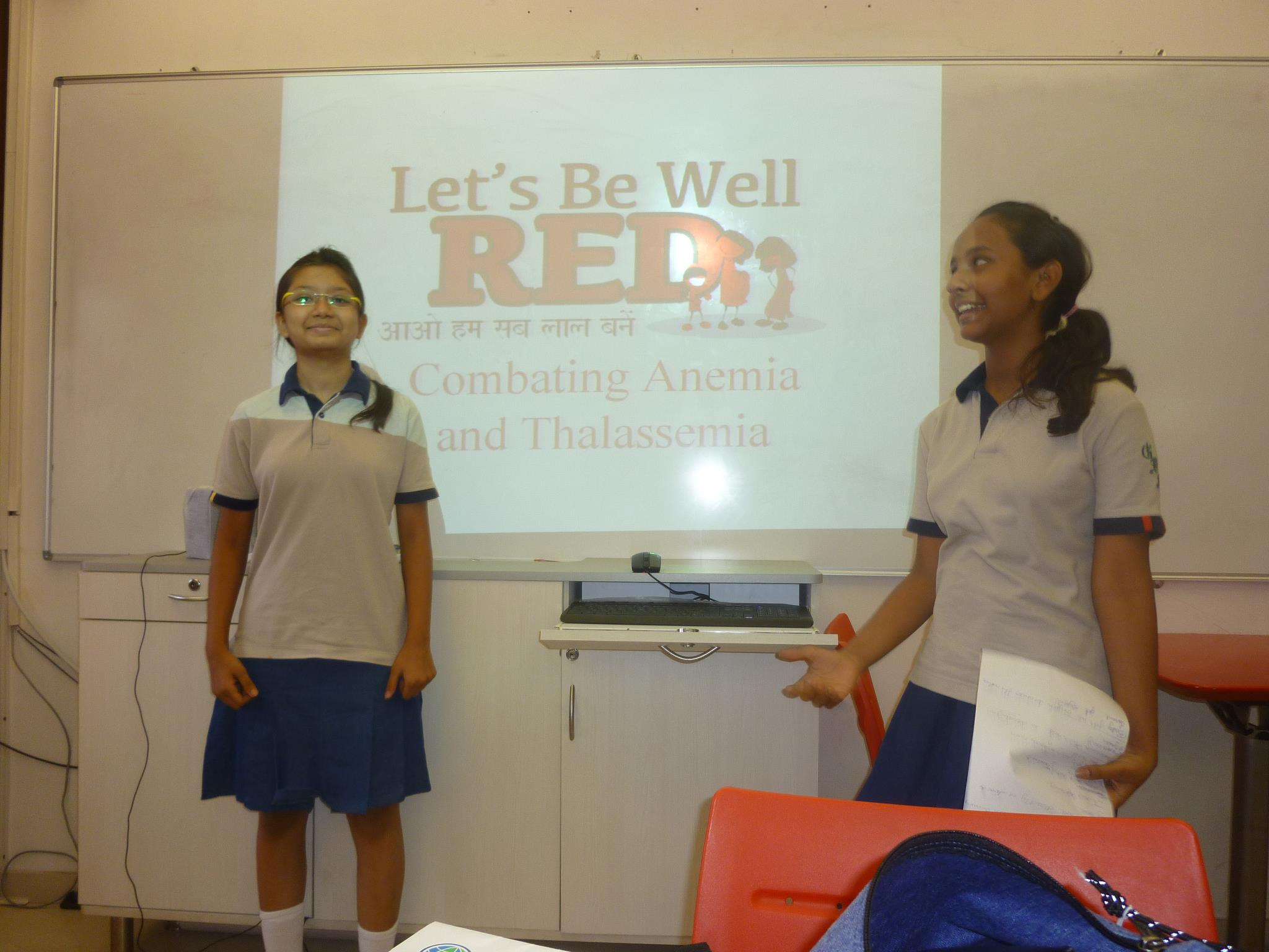 Two of our health scouts in their final training to give an anemia presentation to their school and in their community.