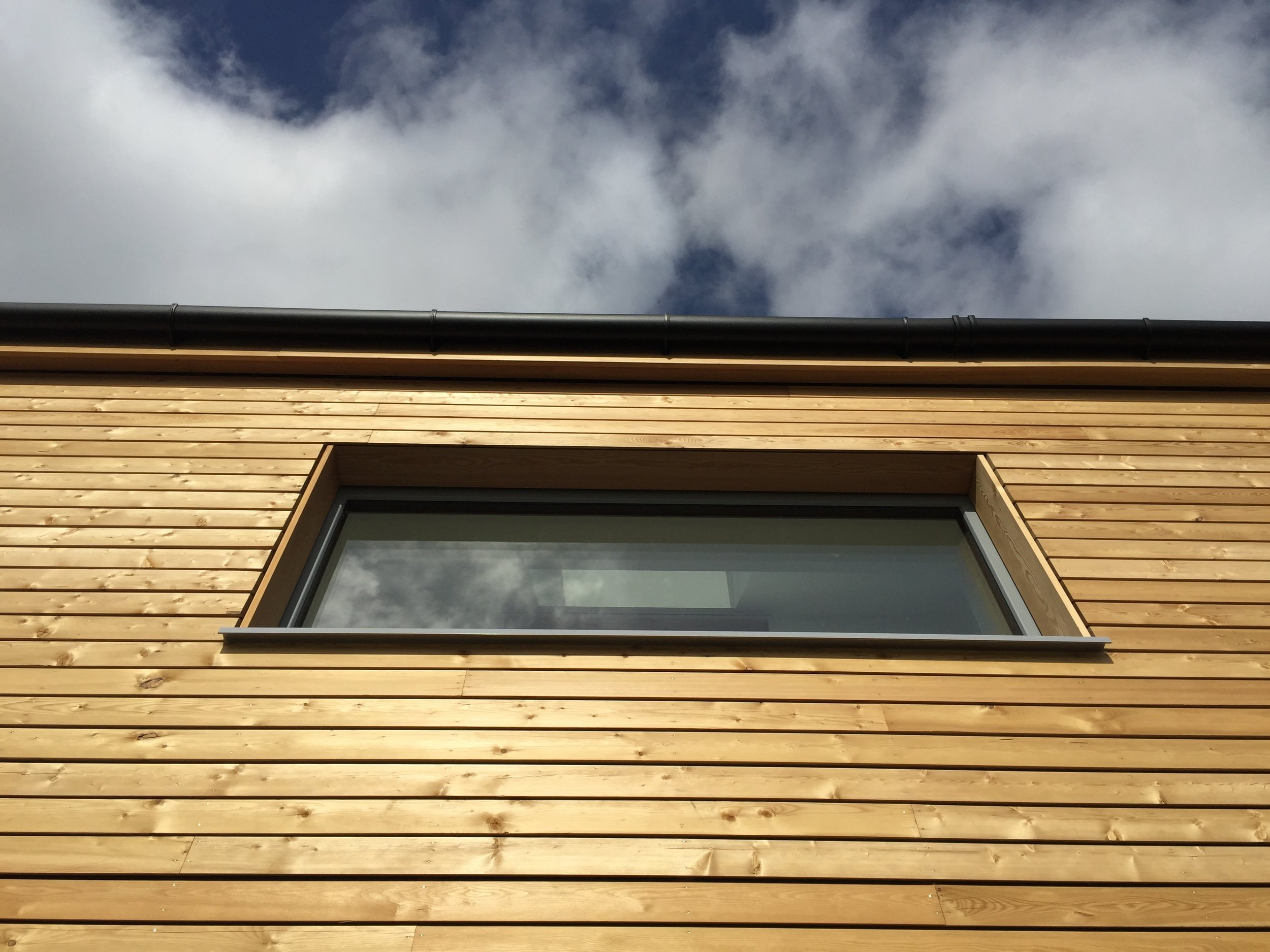 …………open joint timber cladding left untreated to age naturally