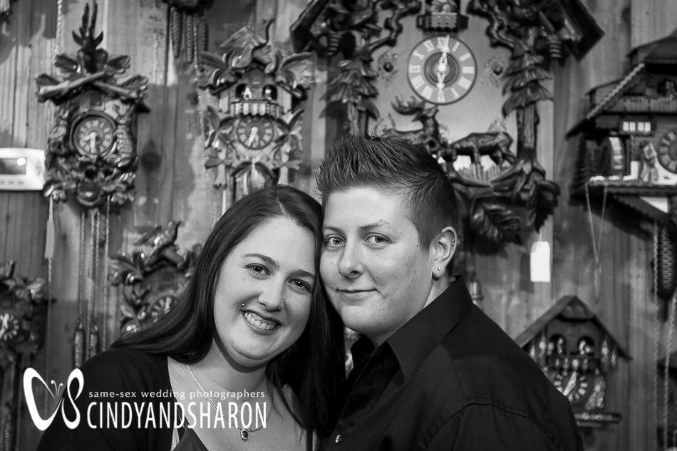 Jessica and Ashton against a wall of cuckoo clocks.