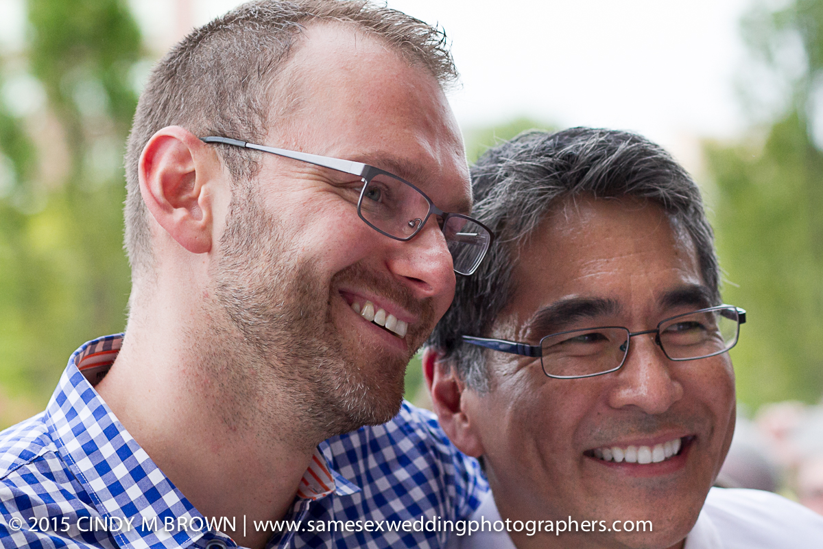 Atlanta City Councilman Alex Wan and his fiance' after Alex proposed during the rally.