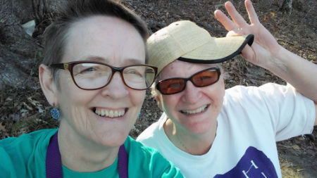Cell phone selfie of Cindy and Sharon on a hiking trail at Stone Mountain.