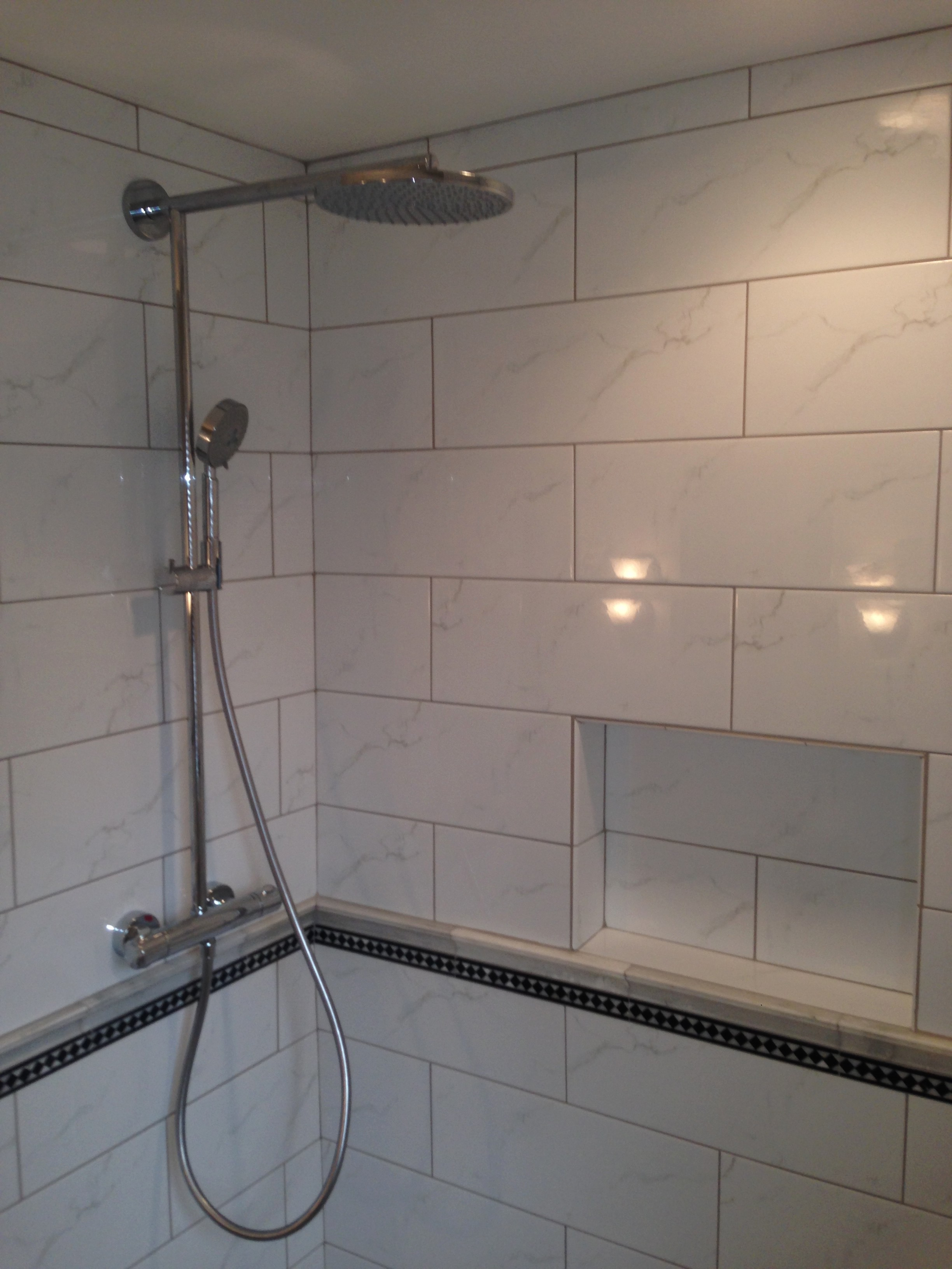 A great shower system made by Hansgrohe. Featuring a rain shower and handheld