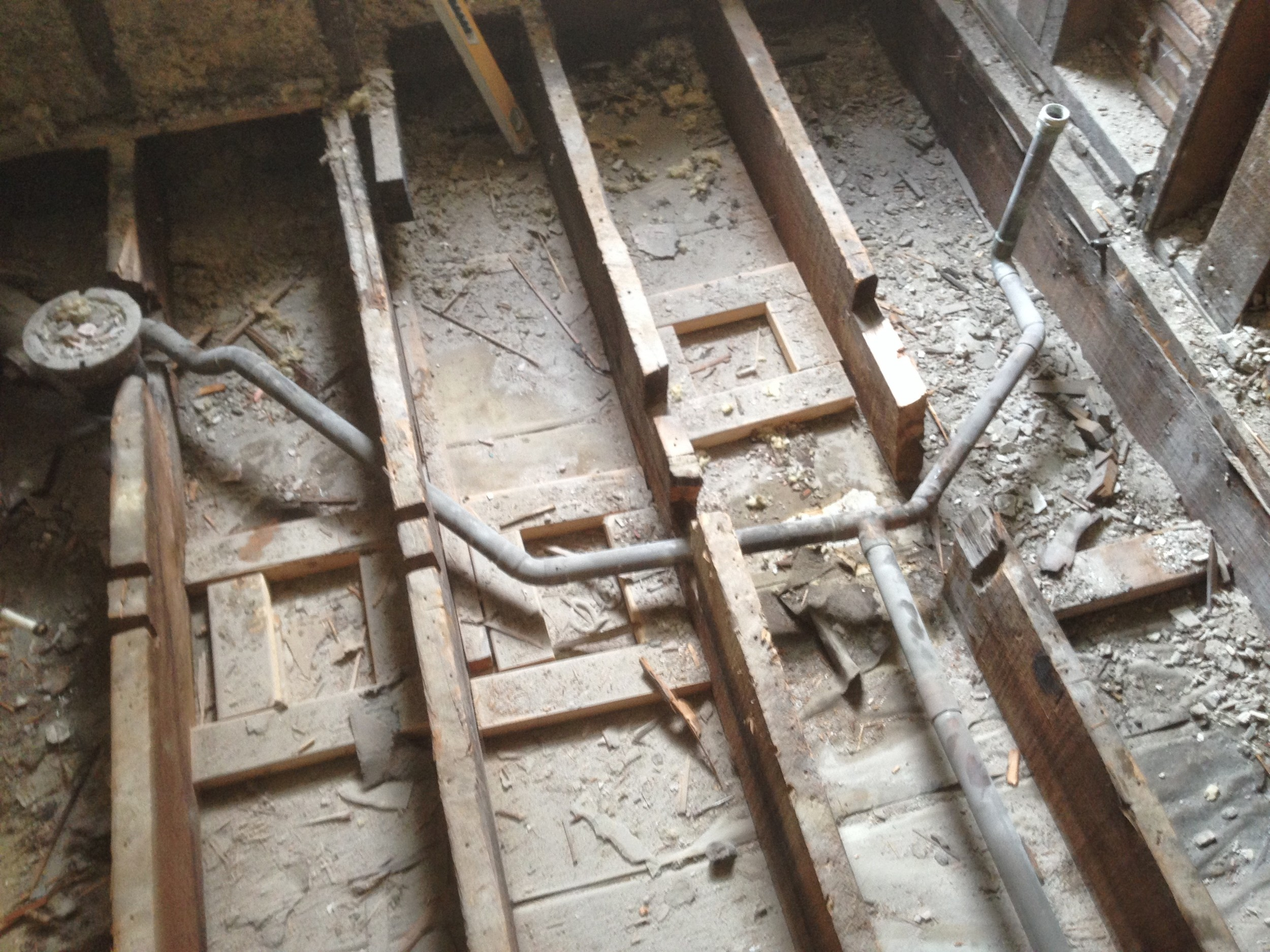 This is an extreme case.....but this was a plumbing job done years ago replacing the original plumbing from house.  At close inspection you can see all the existing structure is compromised by the cutting of joists.