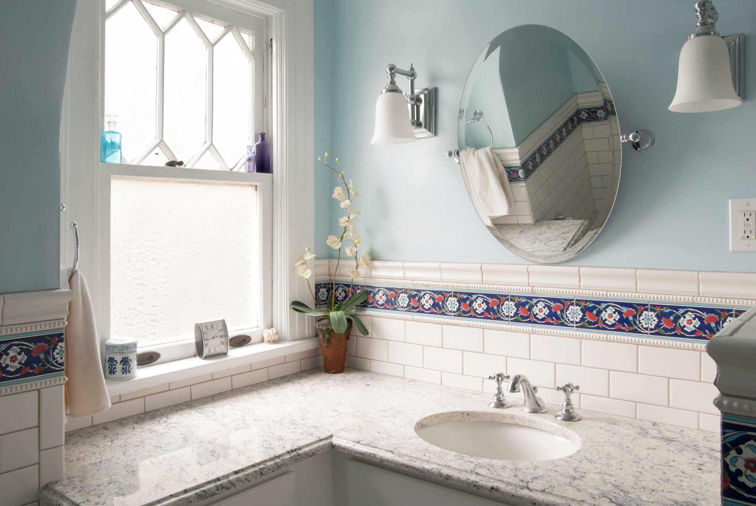 Marble sink and subway tile