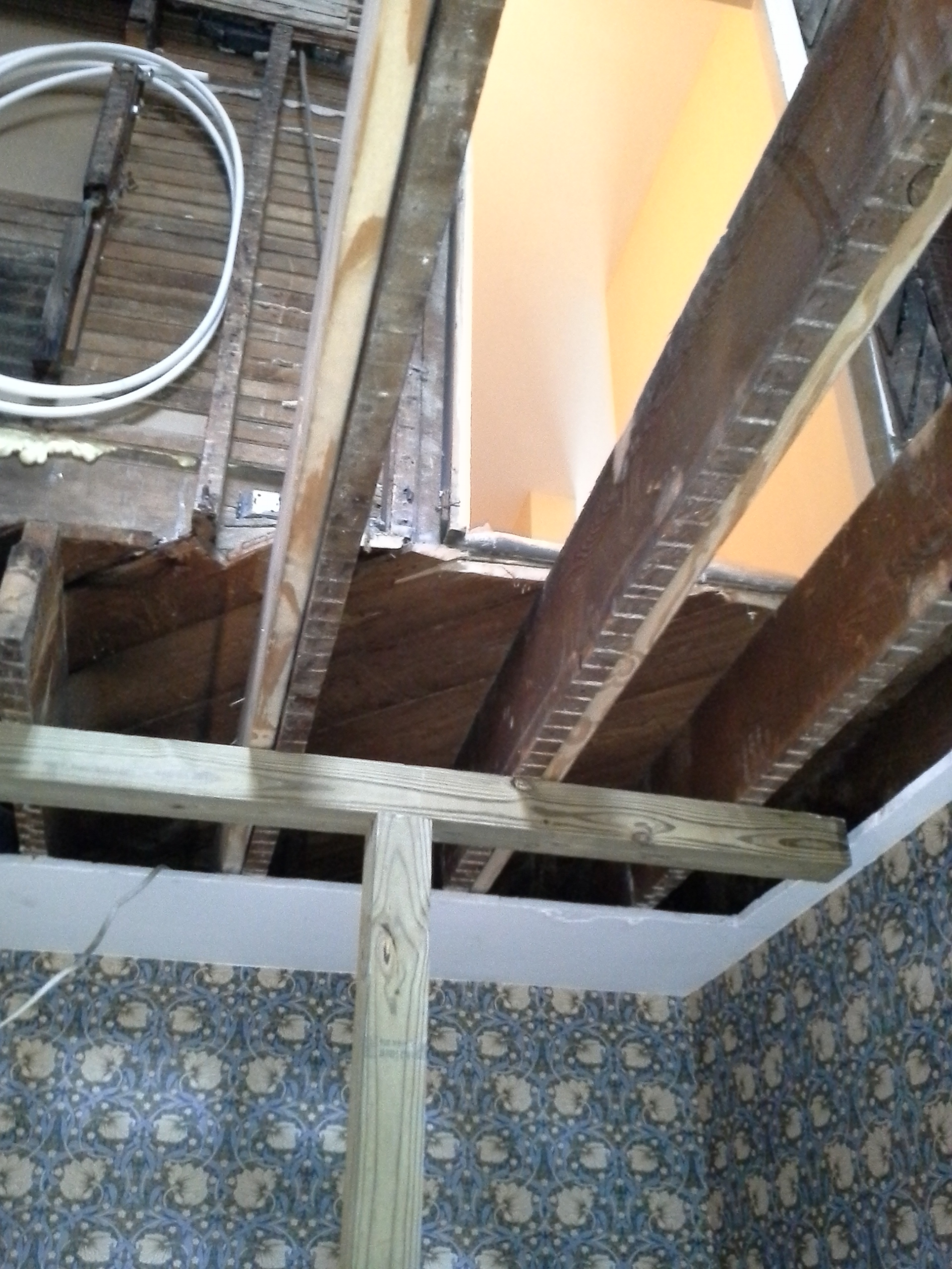 A support post was used to jack up existing floor joists to level.