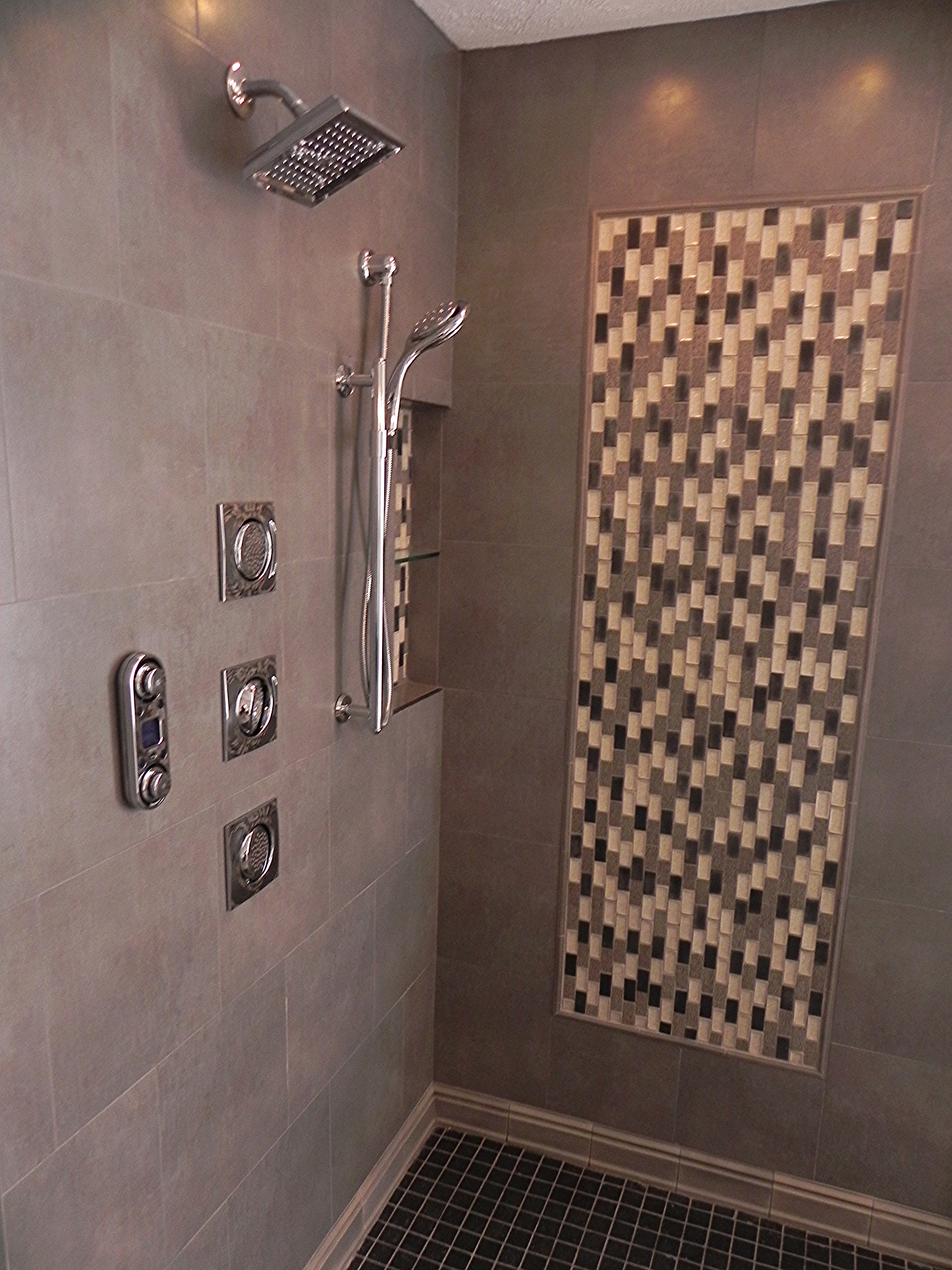"""14"""" x 24"""" recessed niche in corner of shower; Using a metal edging and glass center shelf"""