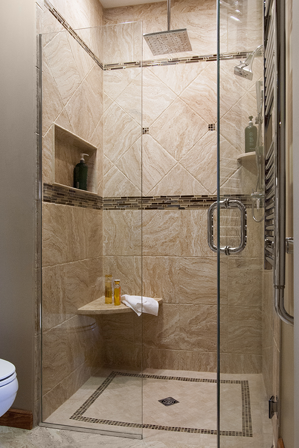 curbless shower with diagonal tile pattern