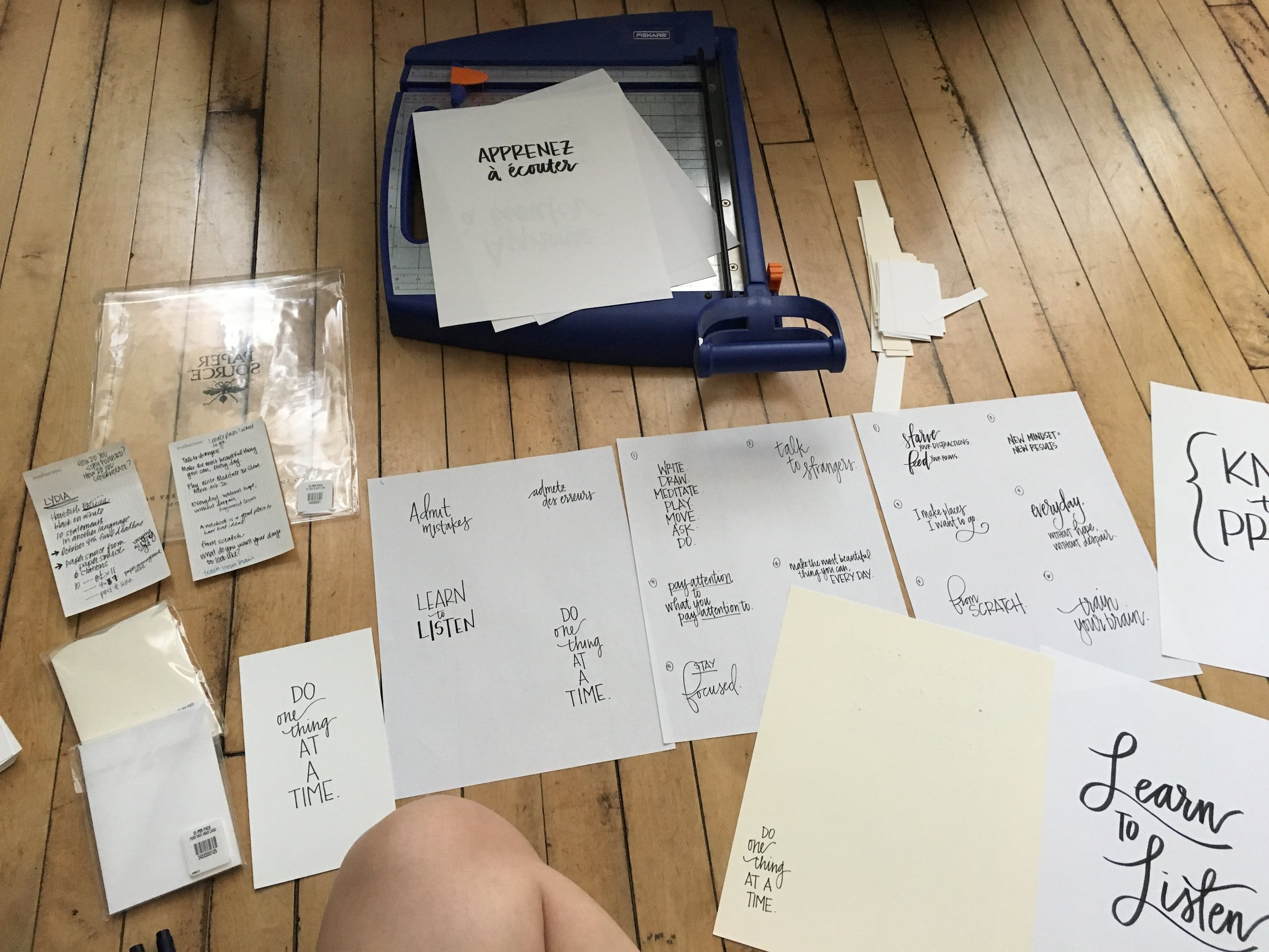 Lots of mapping out which phrase looks / feels best on which size paper. And then lots of paper cutting.