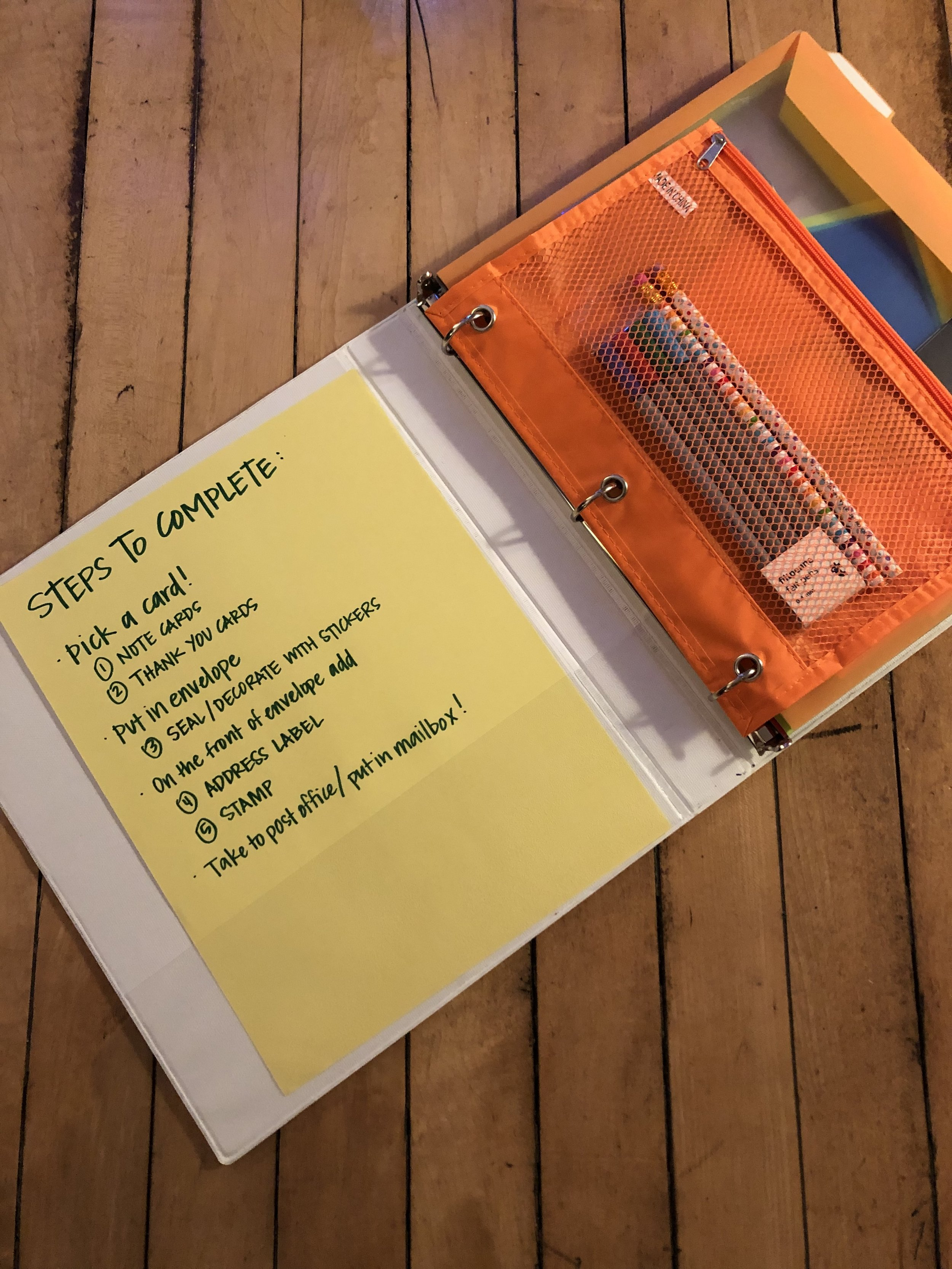 The directions page listed the steps to complete, with the corresponding numbered envelope in the binder. A zippered pouch kept some fancy pens and pencils handy.