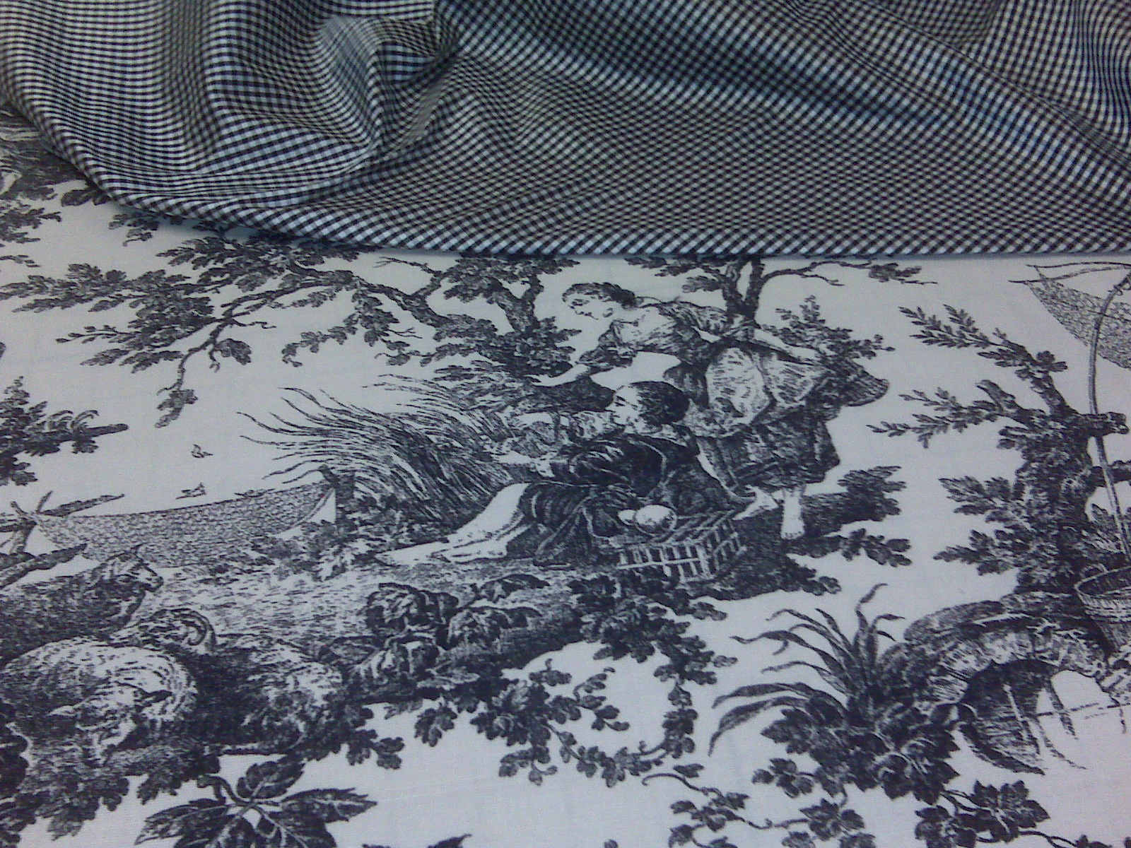 This toile fabric will become some shaped & pleated valances w/the check as bottom banding ... there will be a decorative trim on the band. Will post photos when done.