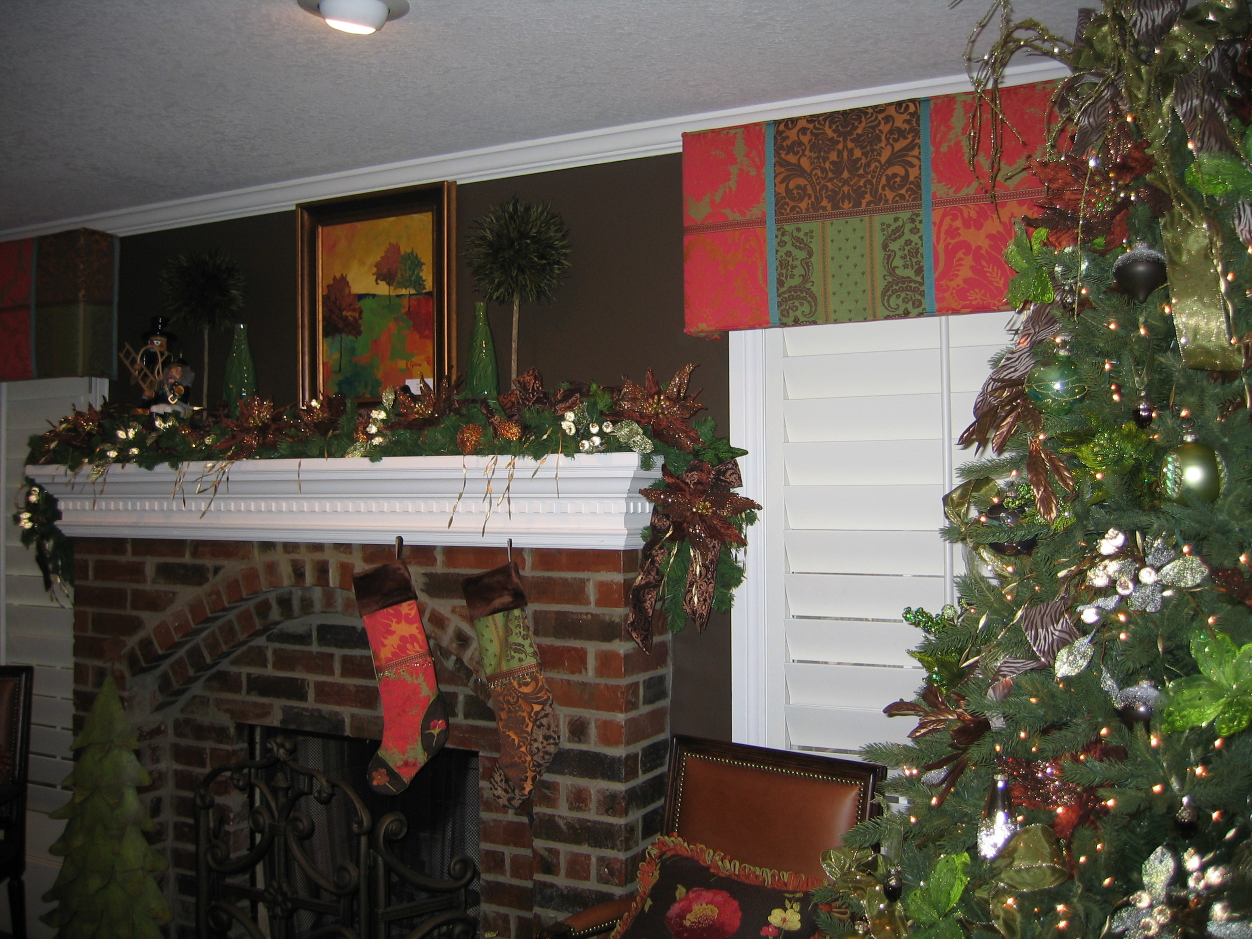 A beautiful Holiday Tree and Mantle - also take note of the hard cornices on the window fabricated by Cord & Pleat Design, Inc.