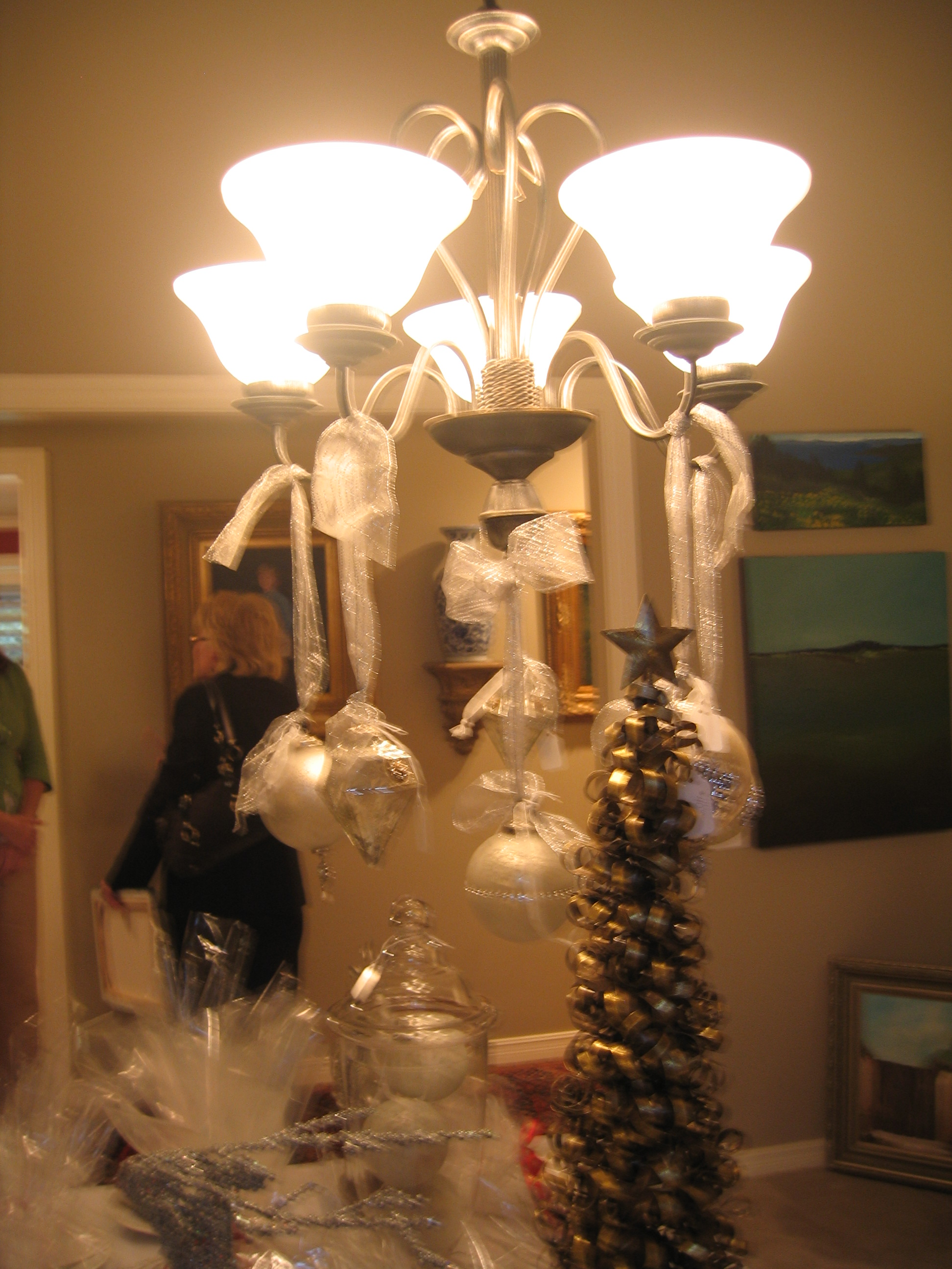 Love the ornaments added to the chandelier.