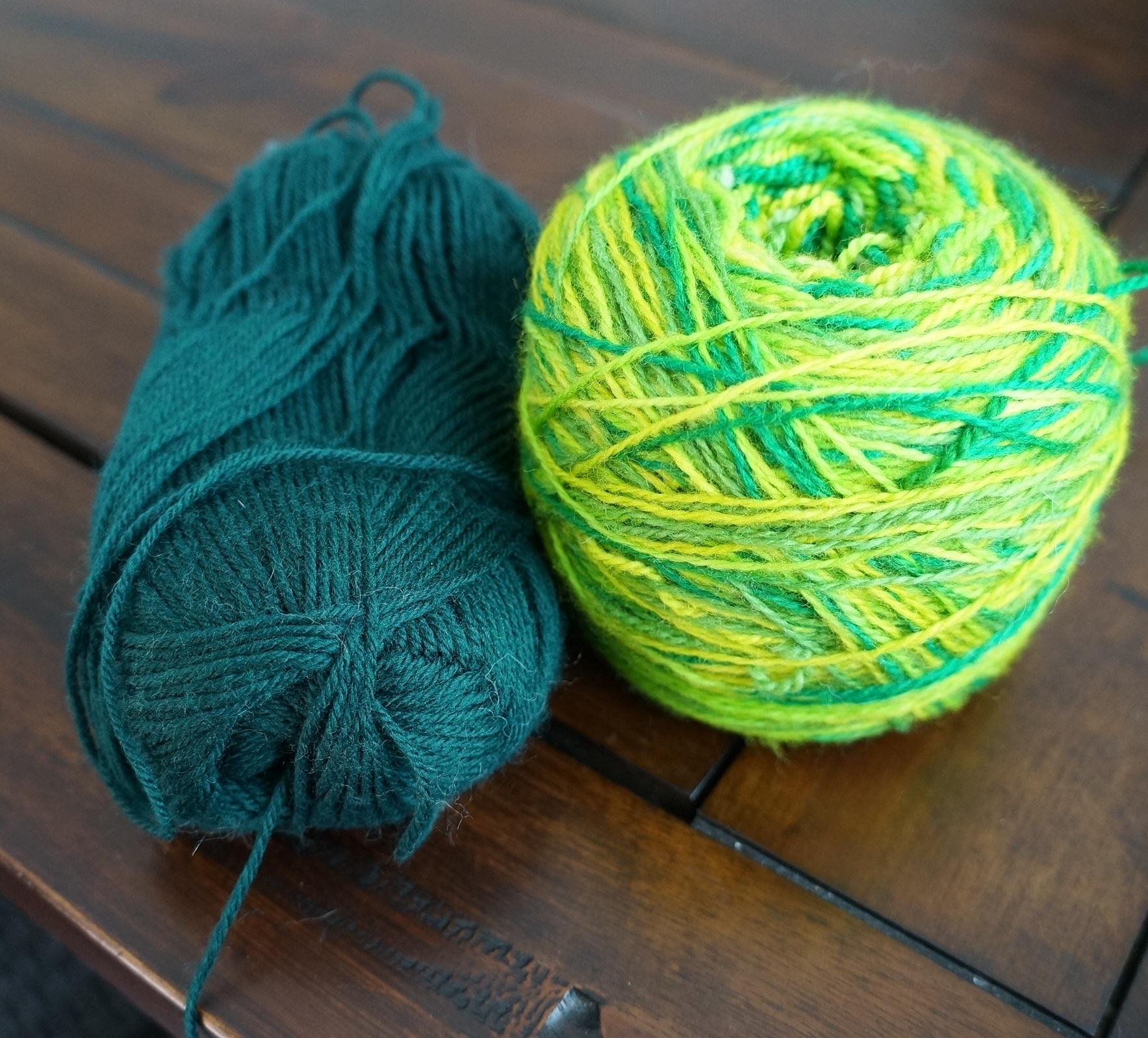 "Left: Knit Picks Stroll in ""Pine"" | Right: Yarn Love Amy March in ""Green with Envy"" (2012 Sock Yarn Club) 100% SW Merino 4 oz 560yds 2-ply."