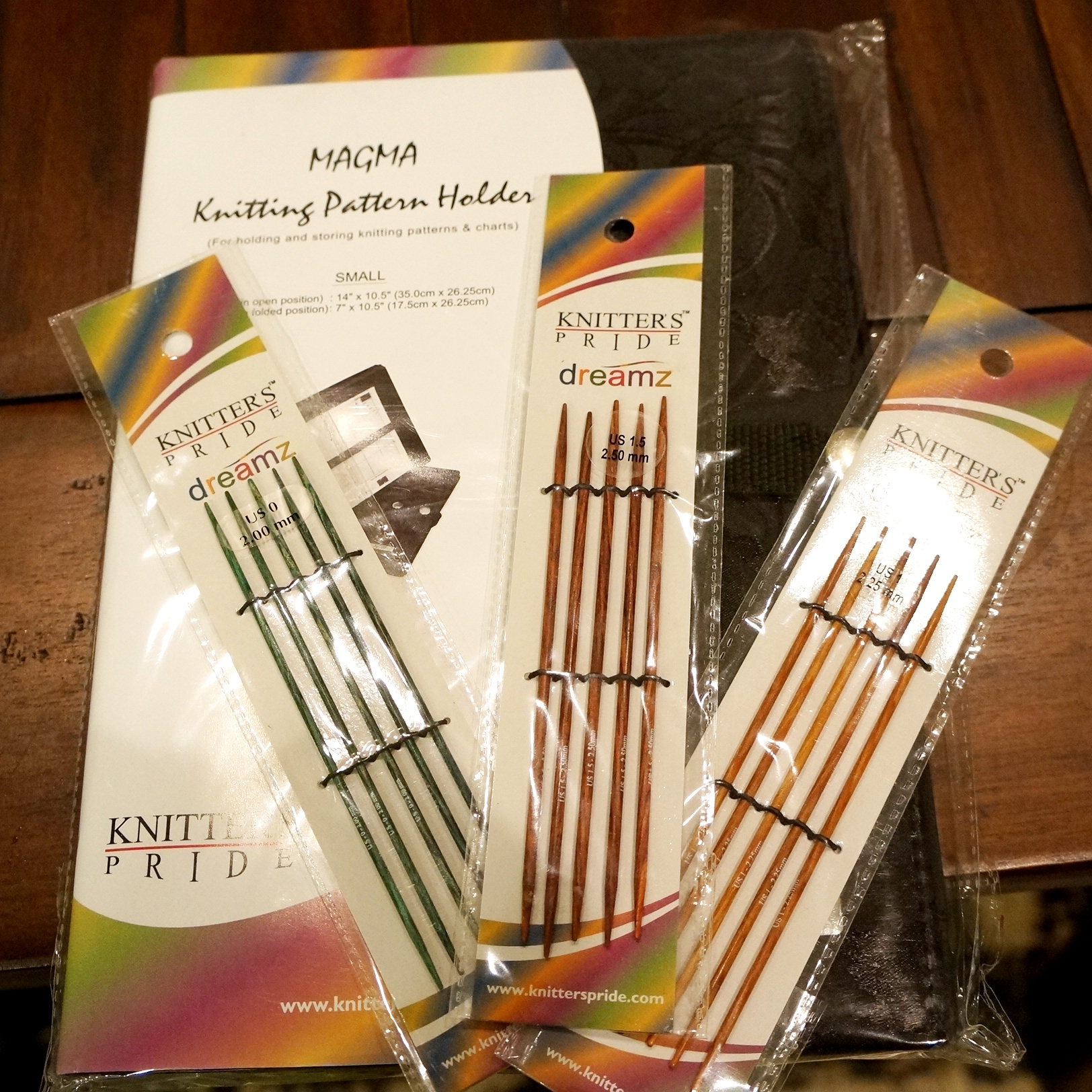 3 sets of Knitter's Pride Dreamz DPNs in Szs 0, 1, and 1.5; and Knitter's Pride Magma Pattern Holder