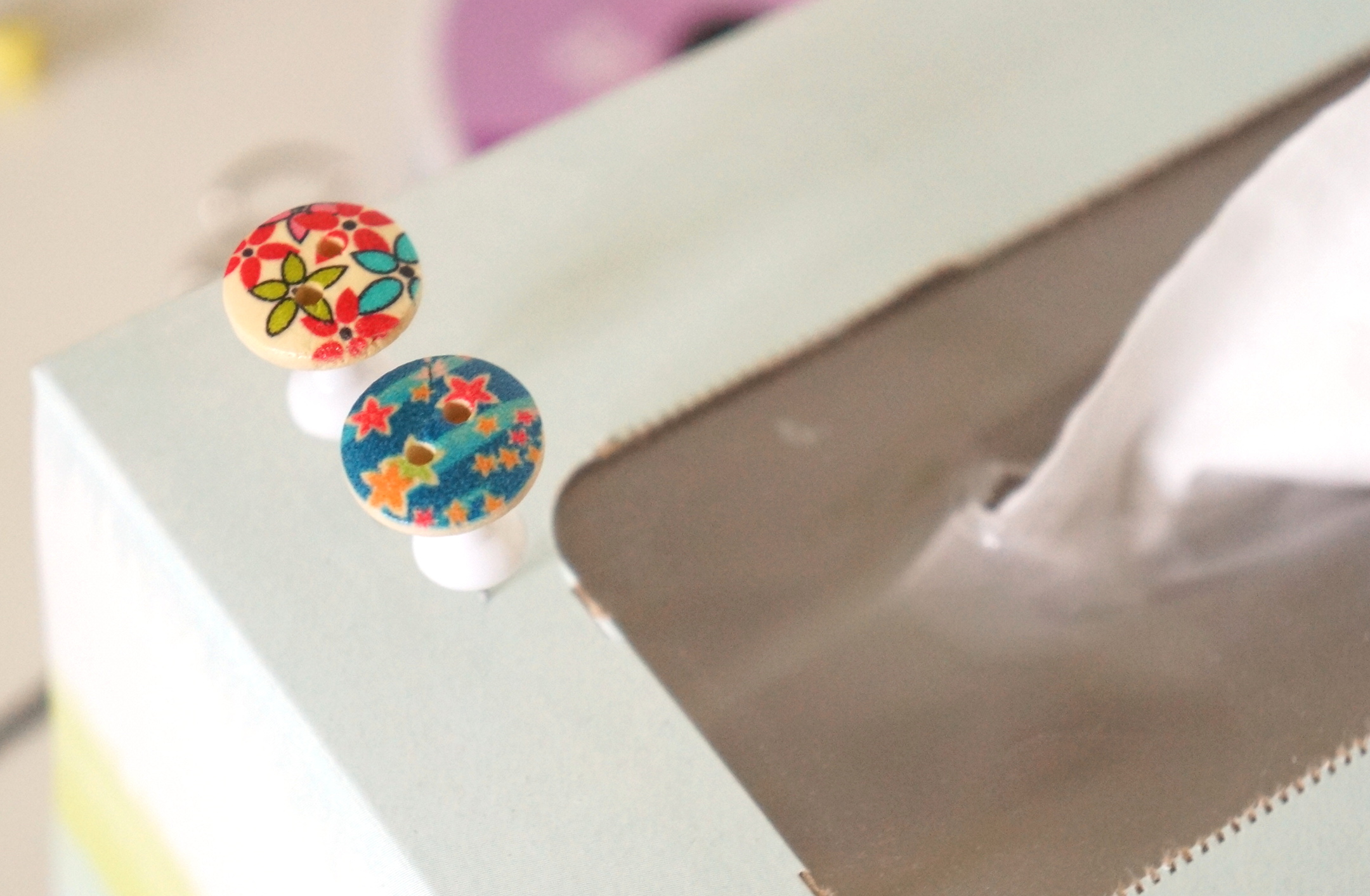 Take regular thumb tacks from office supply stores, and super glue cute buttons on them. | Handmade Fashion at Candy & Bagel