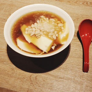 Dou Hua: Tofu Pudding with Peanuts and Ginger Syrup