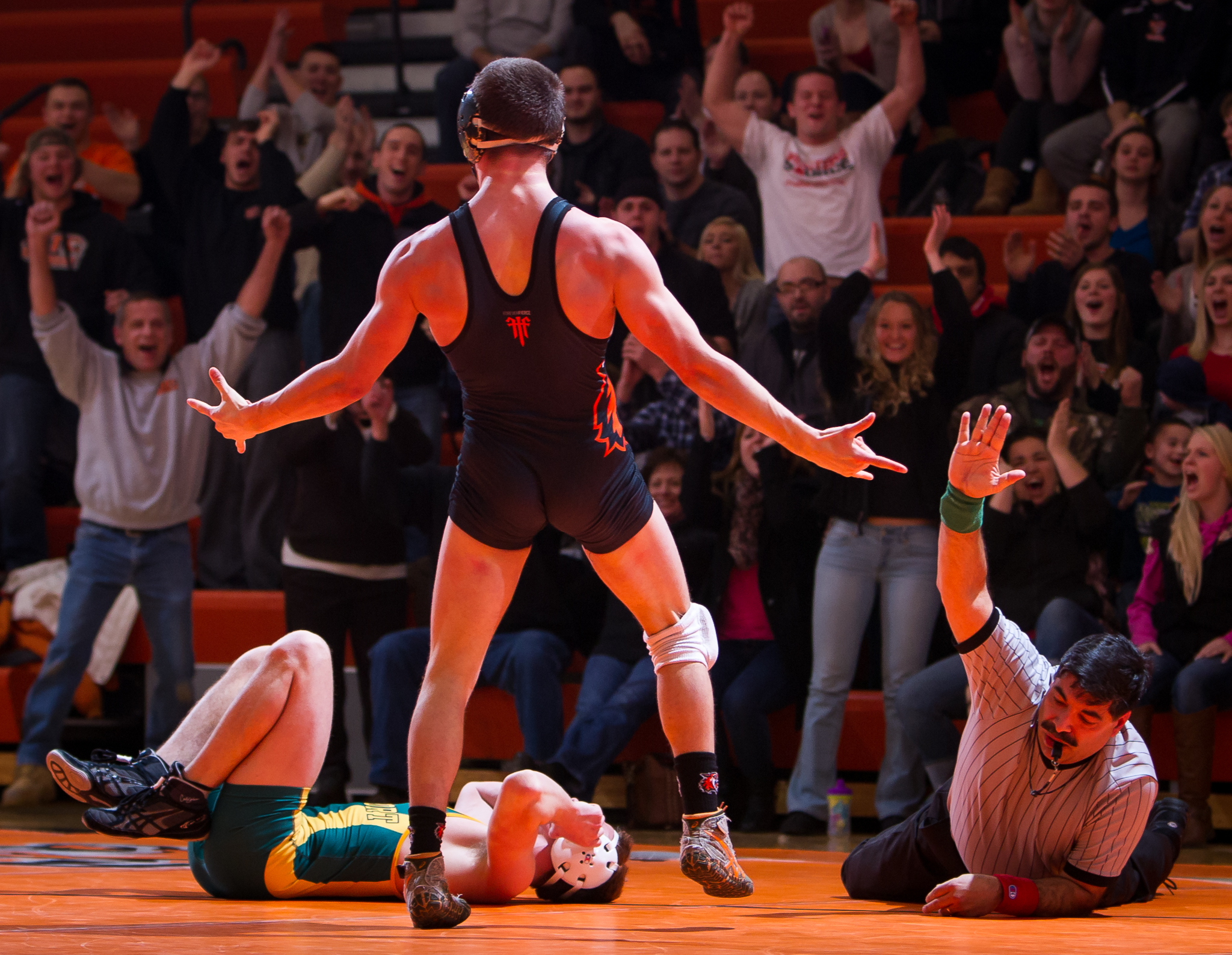 Brad Mayville (RIT) celebrates after winning the 149lb bout by pin during senior night at RIT. Mayville is a senior.