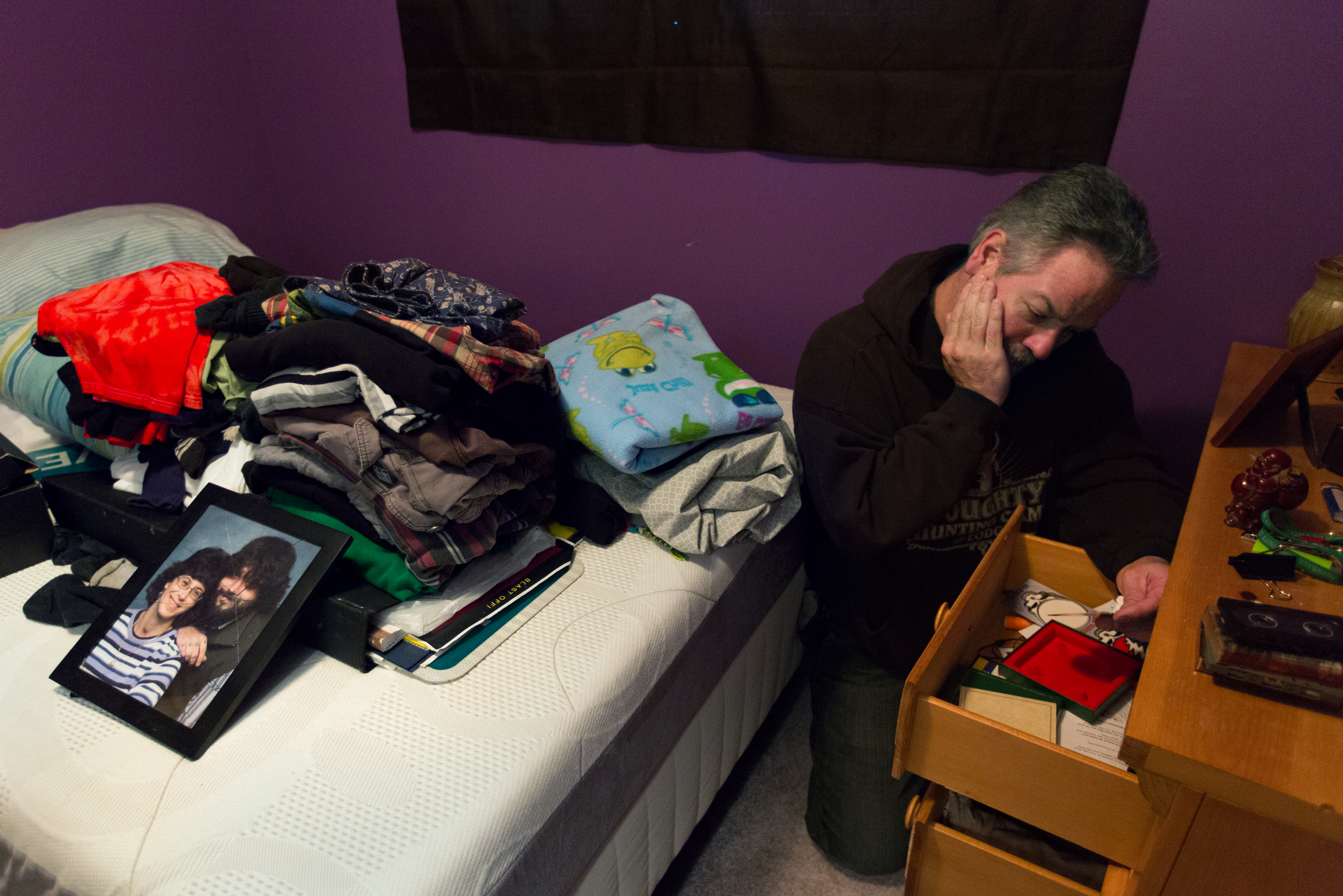 """Ron Doughty goes through Paul Doughty's dresser, finding heroin wrappers, needles, and q-tips on Nov. 17, 2015 in Bridgeport, N.Y. """"I am not ashamed of my son, he just had a disease,"""" said Ron. Paul died of a heroin overdose on Nov. 12, 2015."""
