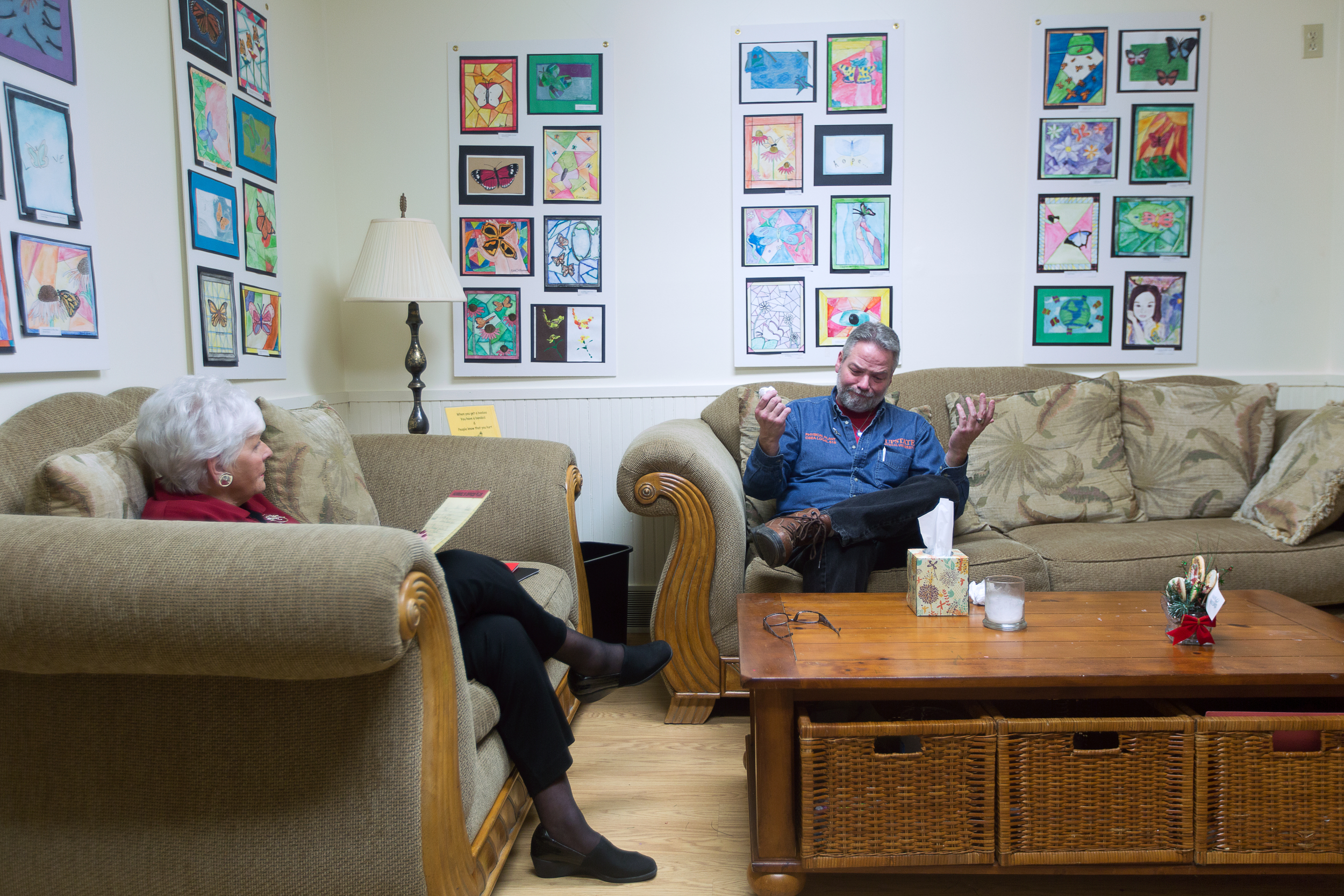 """Ron Doughty speaks with Christine Beattie, a one on one and support group counselor at Hope for Bereaved in Syracuse, N.Y. on Dec. 10, 2015. Christine lost her son to suicide over 30 years ago. """"It helps speaking with someone who has experienced the loss of a child,"""" said Ron."""