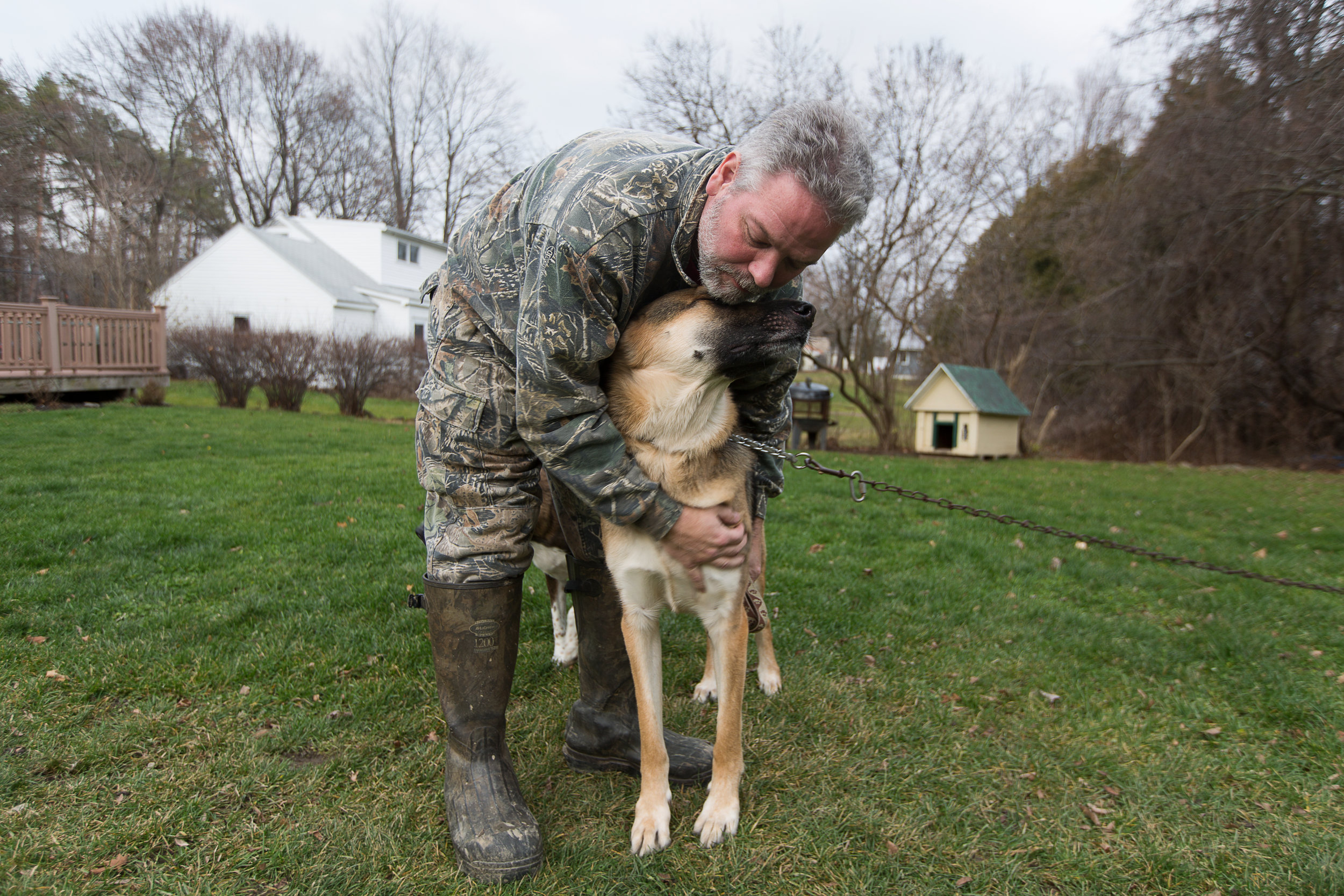 """Ron hugs Doreen's dog Moose at Doreen's house in Jamesville, N.Y. on Nov. 13, 2015. """"The dogs have been very therapeutic for me,"""" said Ron. """"They know something is wrong."""""""