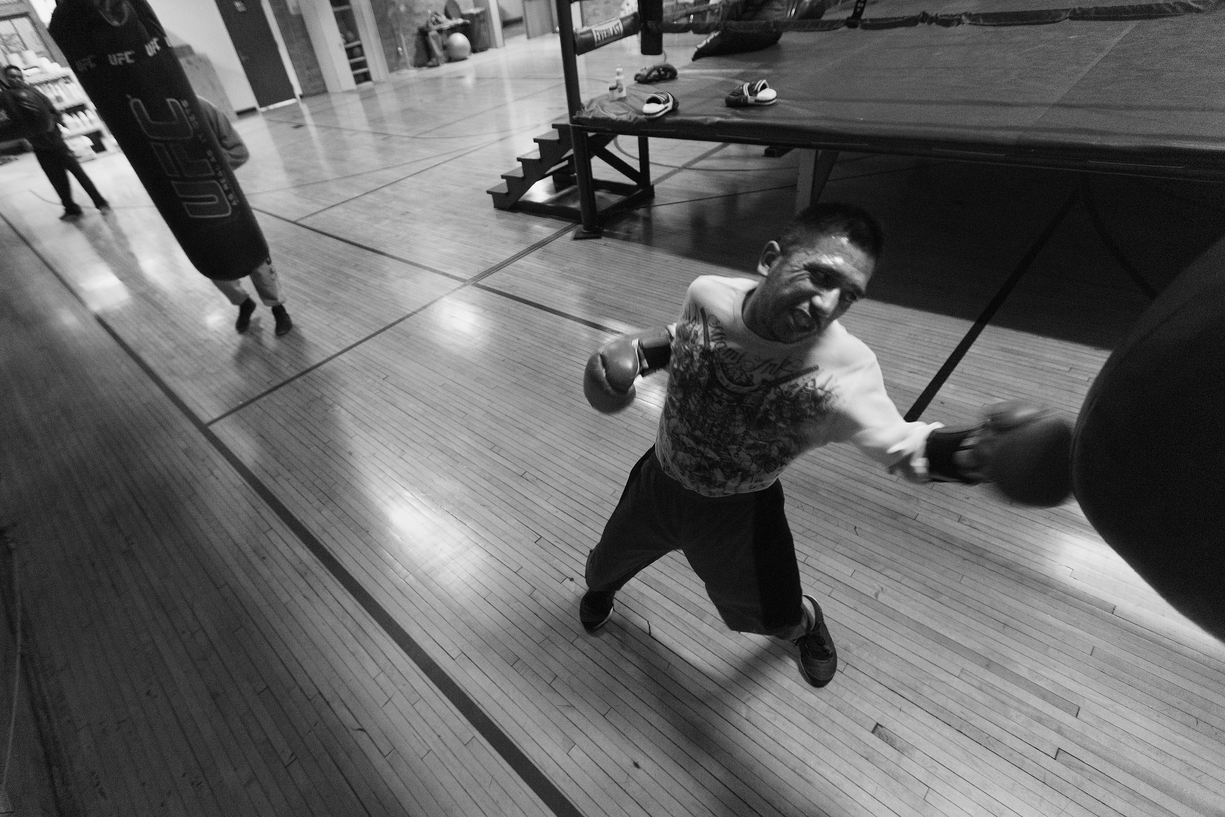 Santiago �Santos� Garcia hits a punching bag during boxing practice at Eastside Boxing Club in Kalamazoo, Mich. on May 17, 2016. Garcia won the Michigan Golden Glove novice class state championship at the 108 pound weight class in 2015 and 2016. (Bryan Bennett | MLive.com)