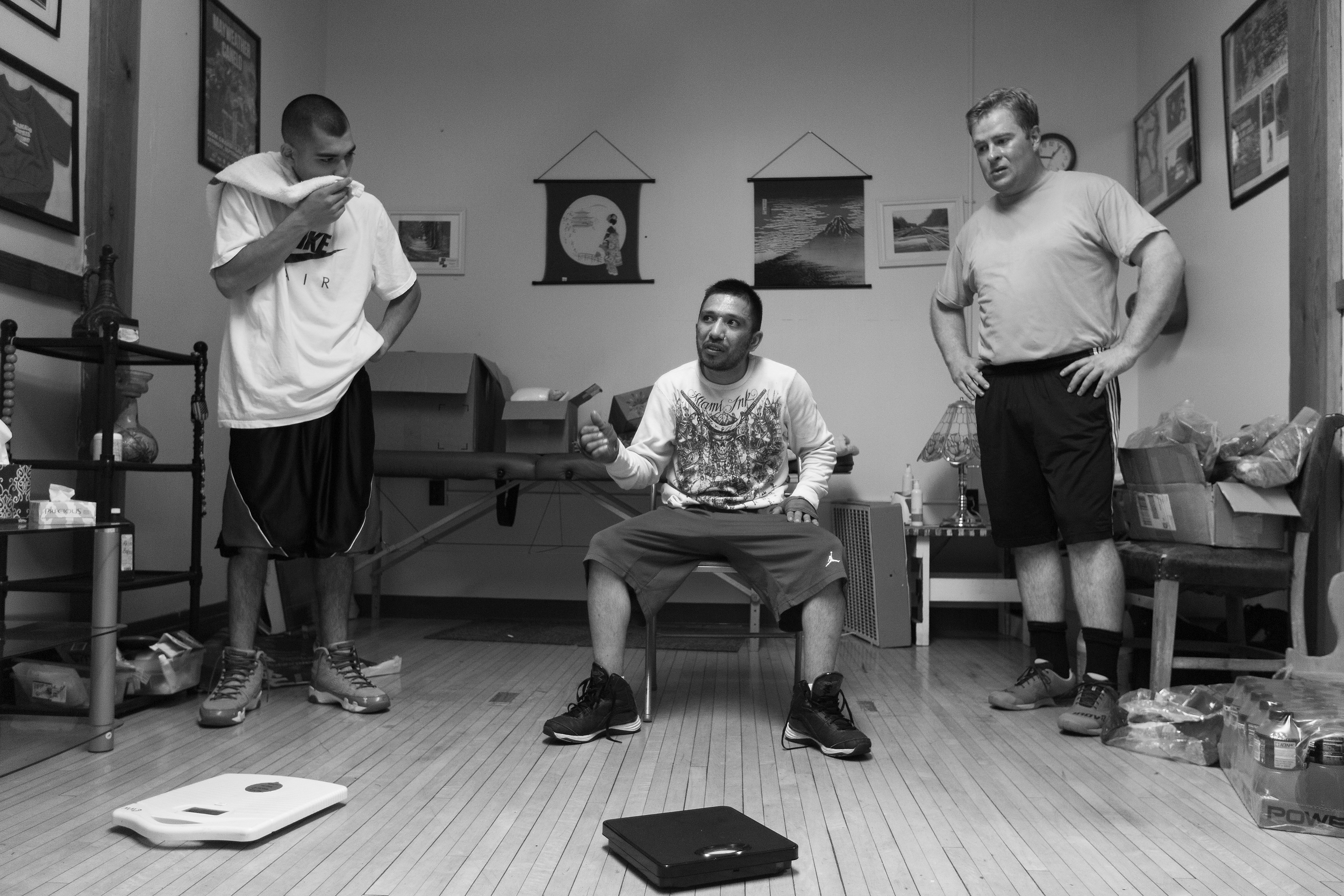 Chuy, left, Santiago �Santos� Garcia, center, and Fletcher stand in Curtis Isaac�s office after boxing practice at Eastside Boxing Club in Kalamazoo, Mich. on May 17, 2016. Garcia won the Michigan Golden Glove novice class state championship at the 108 pound weight class in 2015 and 2016. (Bryan Bennett | MLive.com)