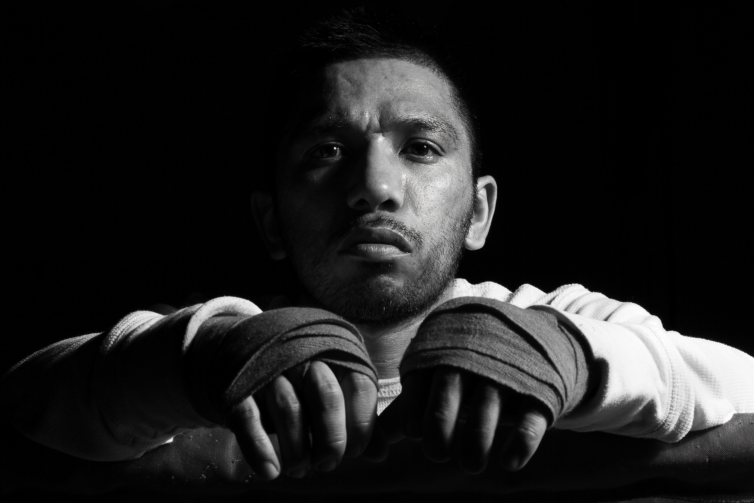 """Santiago """"Santos"""" Garcia is photographed at Eastside Boxing Club in Kalamazoo, Mich. on May 17, 2016. Garcia won the Michigan Golden Glove novice class state championship at the 108 pound weight class in 2015 and 2016. (Bryan Bennett 