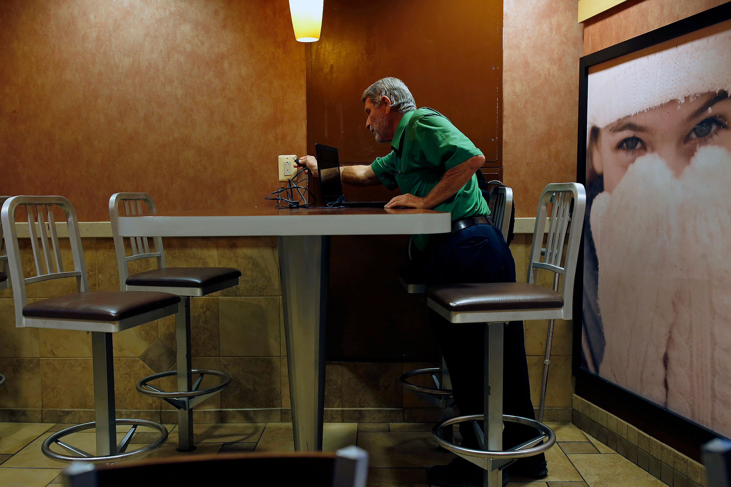 Ron plugs his computer in at the local McDonalds. He checks his email and gets his daily coffee.