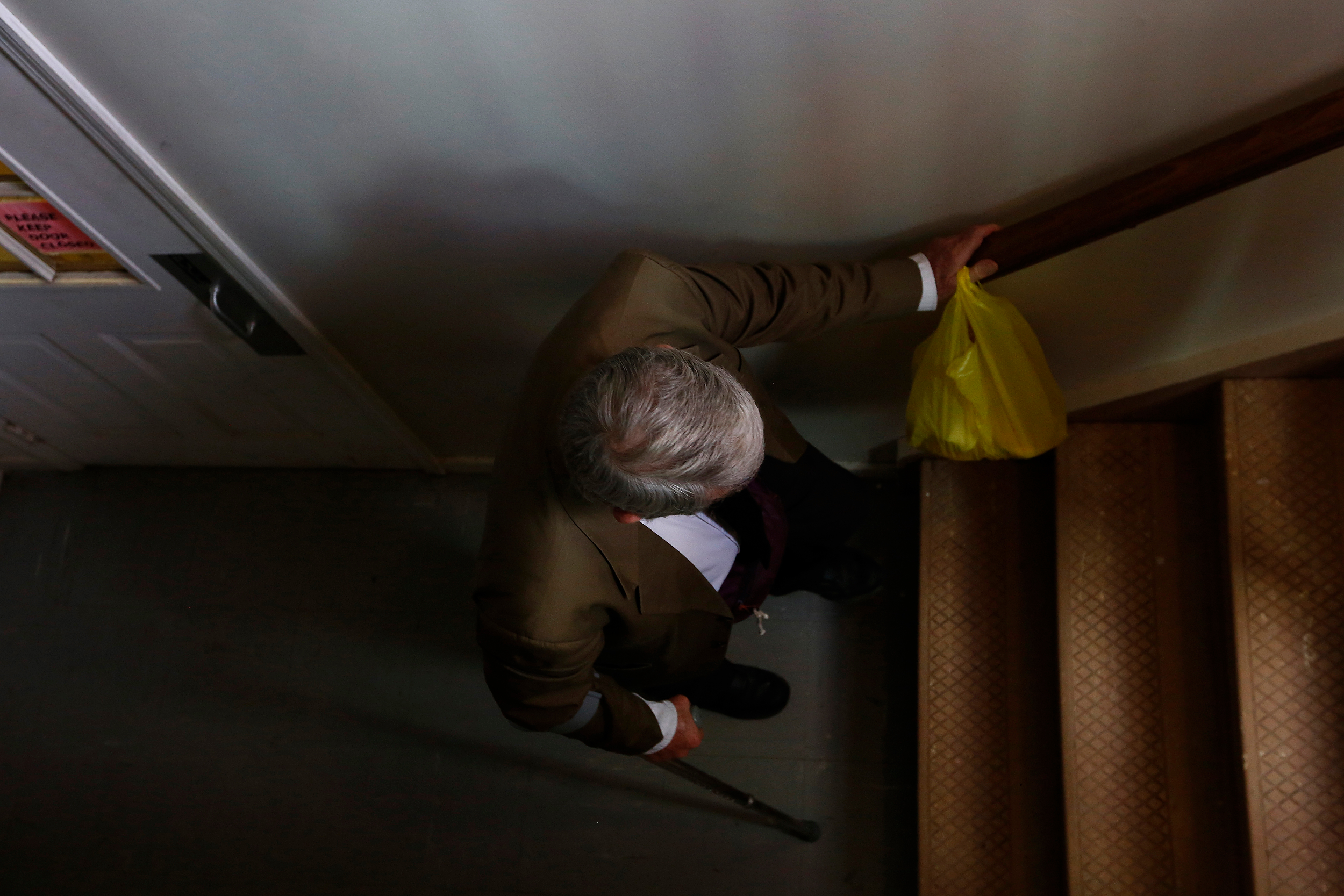 Ron walks up the stairs while at church. Ron believes that if he goes to church then something good will happen to him.
