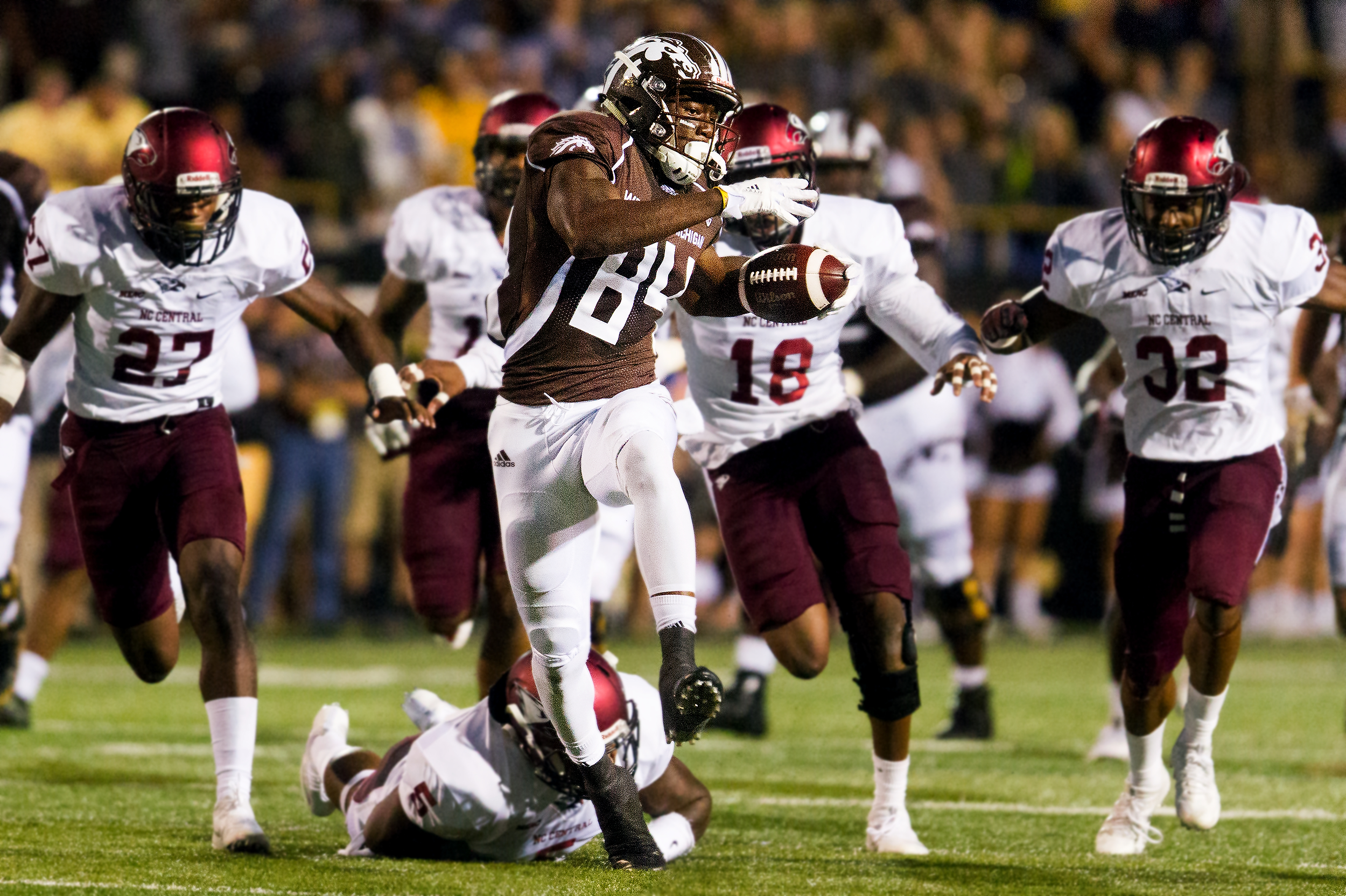 Western Michigan Broncos wide receiver Corey Davis (84) breaks a tackle after catching the ball during the first half against North Carolina Central. Davis scored his second touchdown of the night on the 46-yard play and WMU defeated NCCU 70-21.