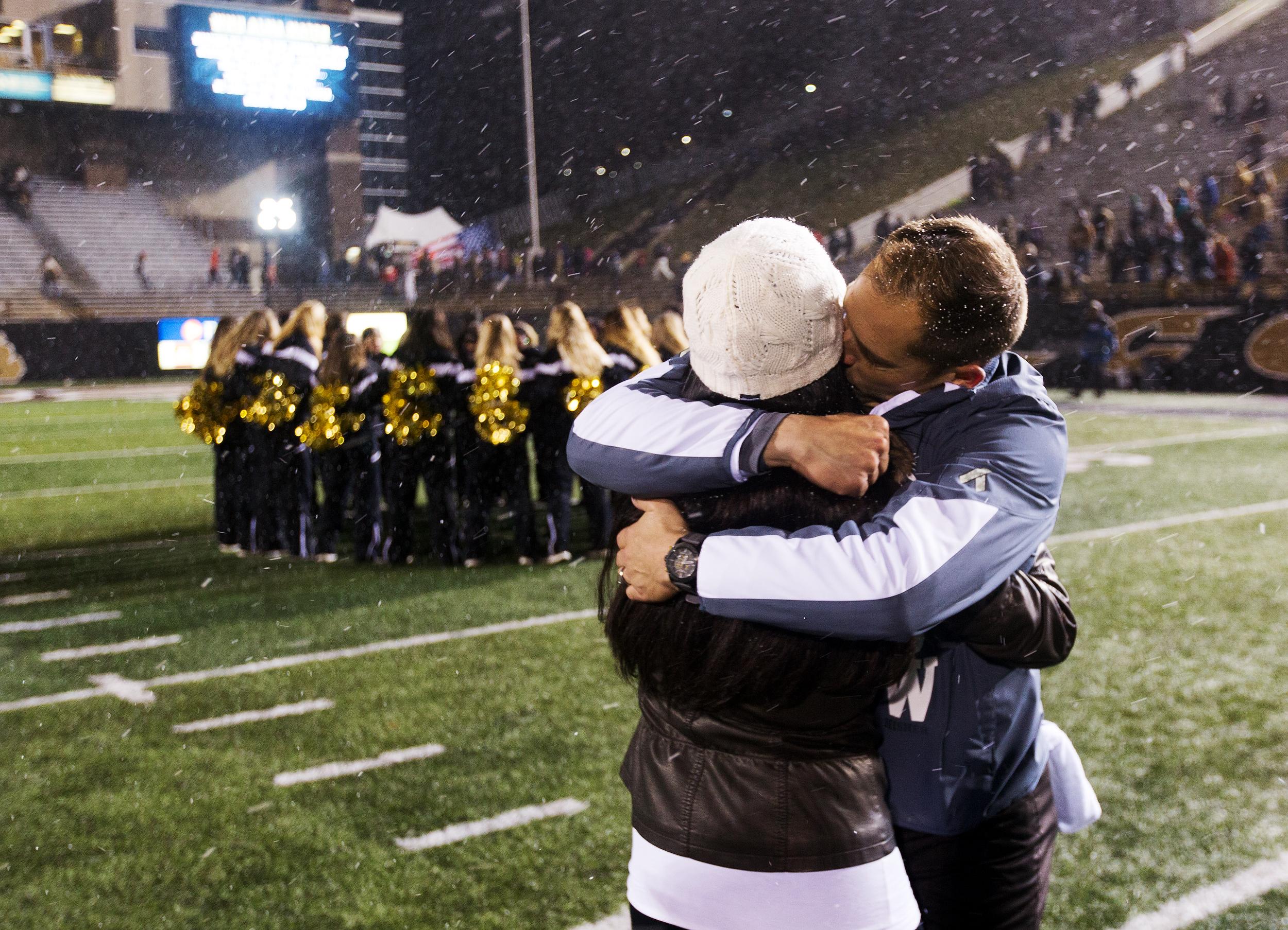 Broncos head coach P.J. Fleck kisses his wife Heather Fleck after his team defeated the Buffalo Bulls 38-0 on Nov. 19, 2016.
