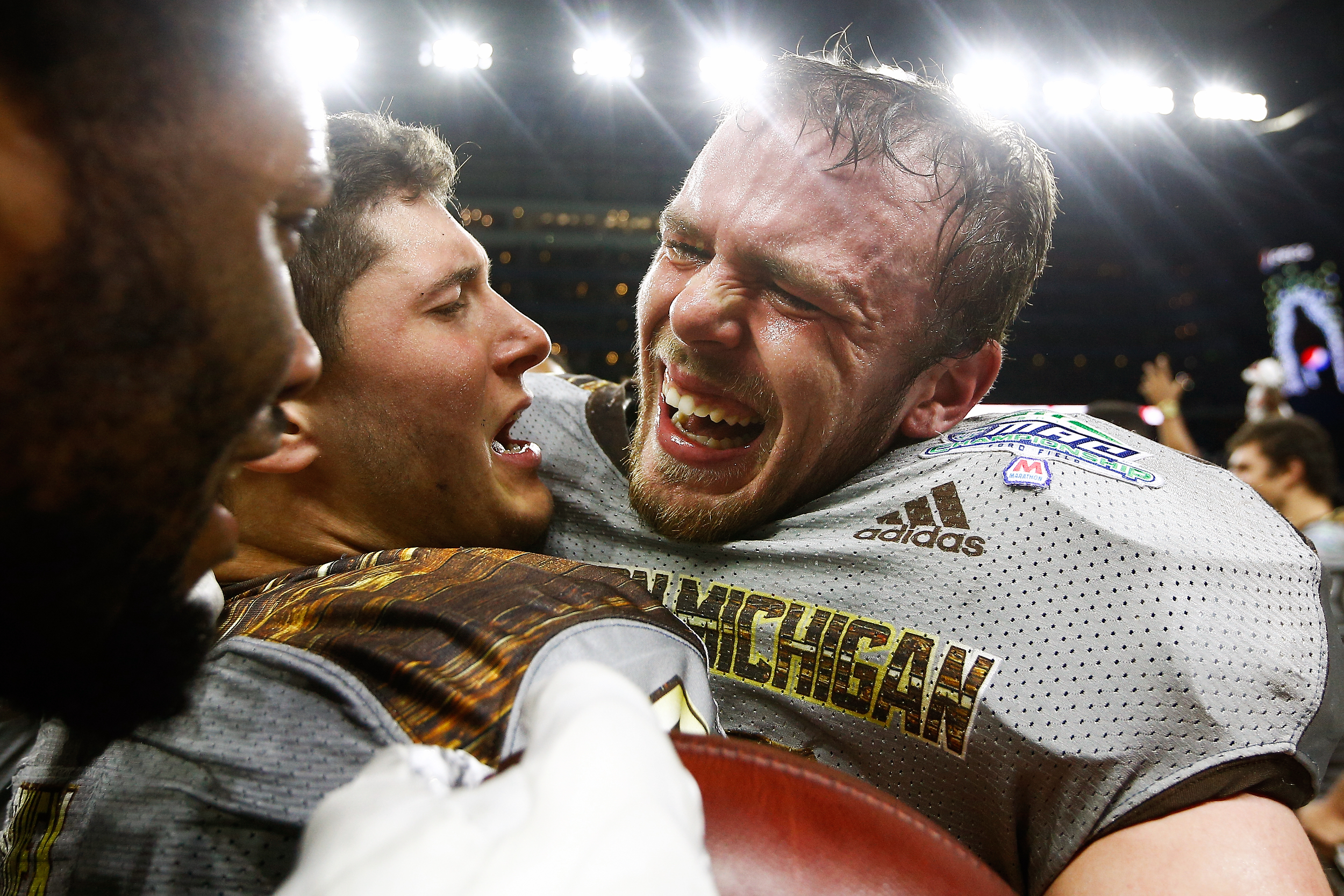 Broncos linebacker Robert Spillane (10) is greeted by teammates after a game winning interception against the Ohio Bobcats, securing the Mid-American Conference championship.
