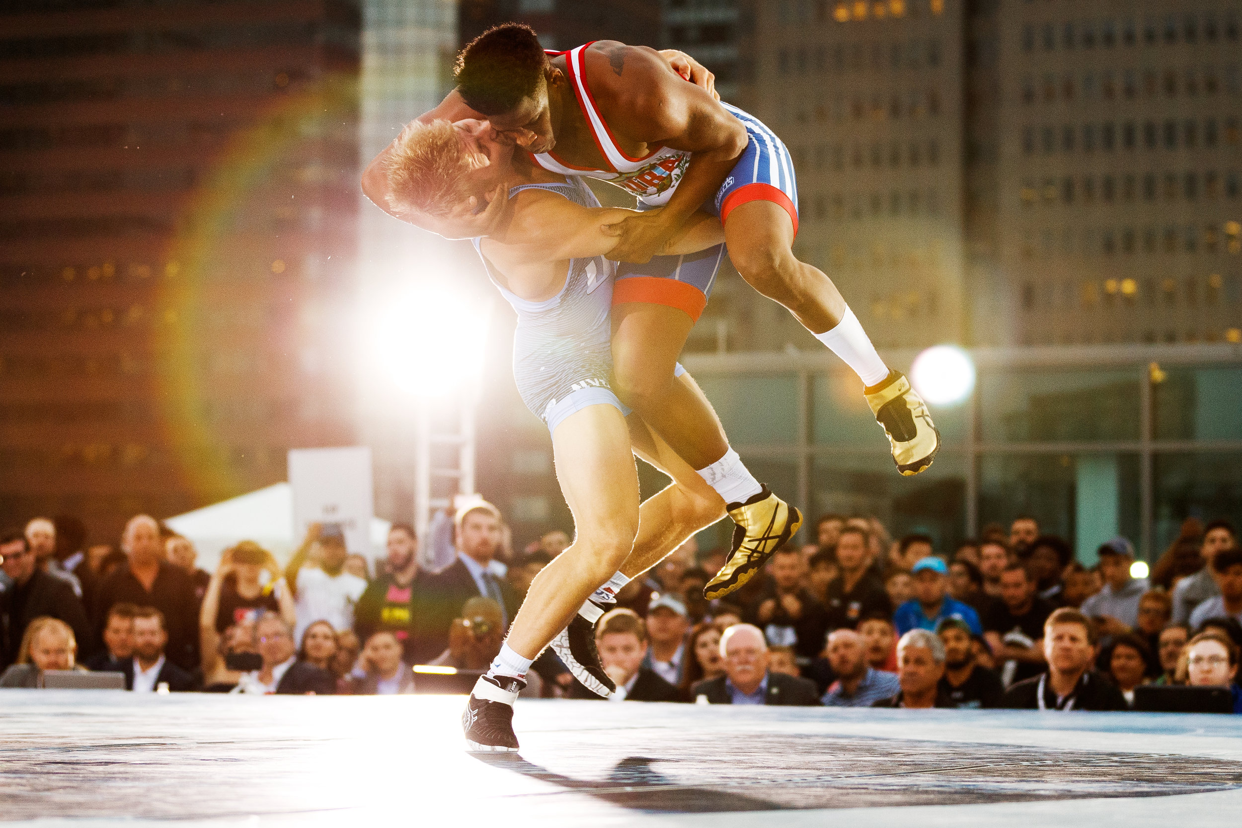 Kyle Dake, USA, lifts Livan Lopez Azcuy, Cuba, off of the mat during the 79kg match at Beat the Streets - Rumble on the River on May 17, 2018 in New York City. Dake defeated Lopez Azcuy by technical fall (13-1) in the third period. (Photo by Bryan Bennett)
