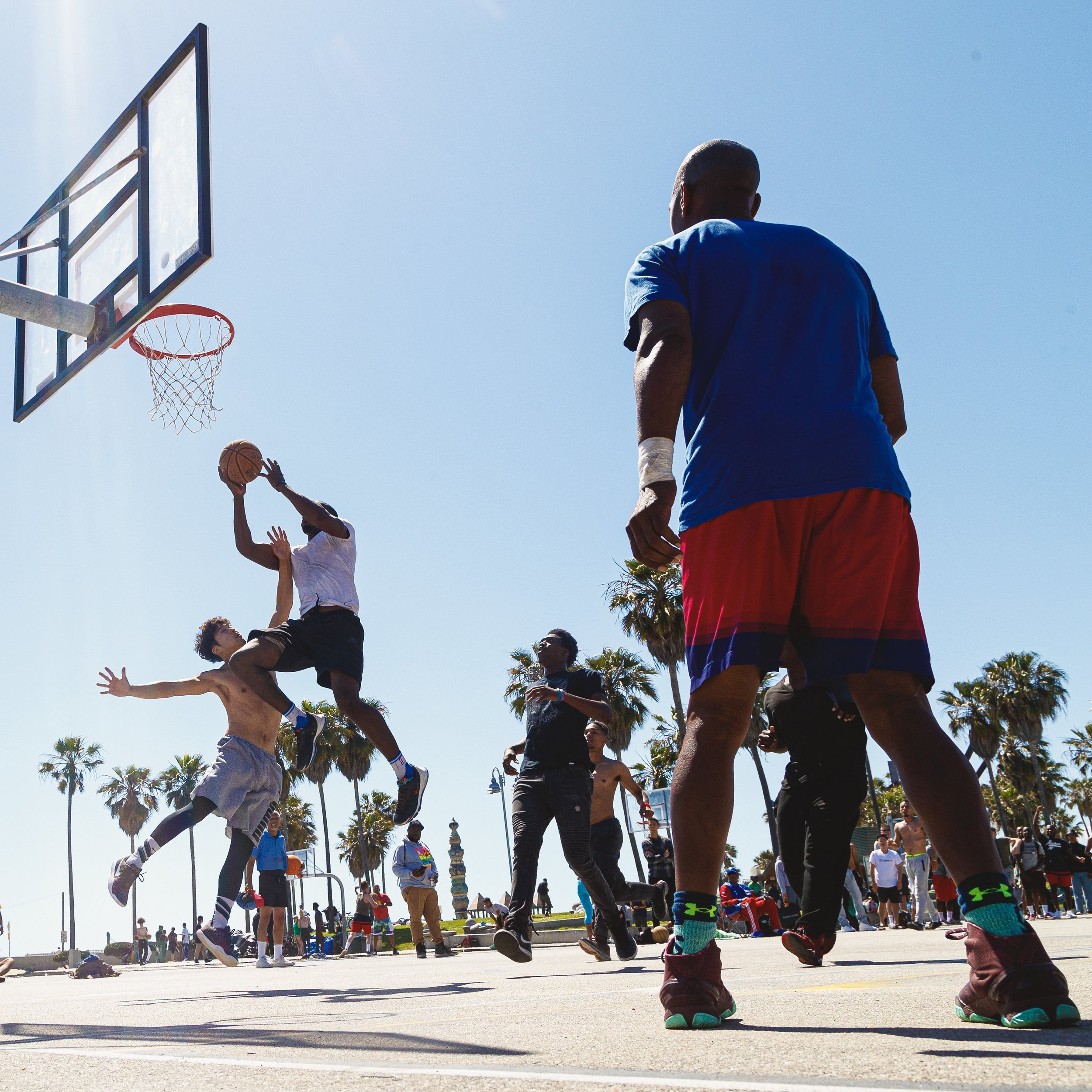 People play basketball at Venice Beach Basketball Court on May 27, 2019 in Venice Beach, Calif.. (Photo by Bryan Bennett)