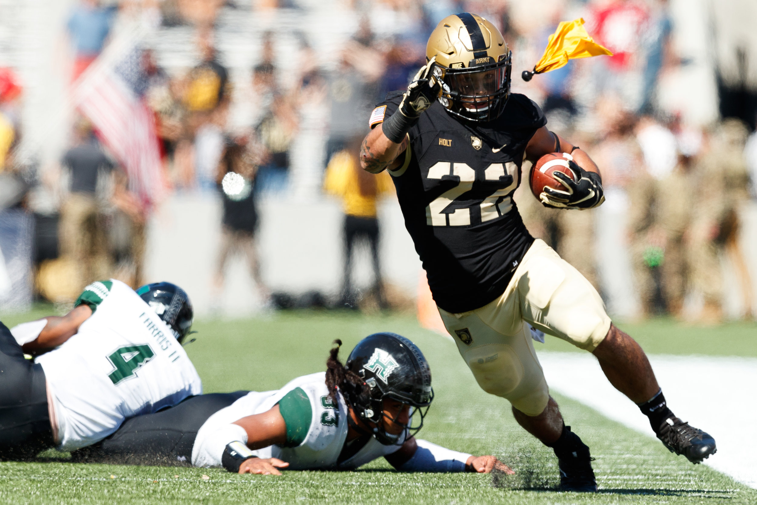 Calen Holt #22 of the Army Black Knights runs the ball as a flag is thrown during a game against the Hawaii Warriors at Michie Stadium in West Point, N.Y. on Sept. 15, 2018. Army defeated Hawaii 28-21.