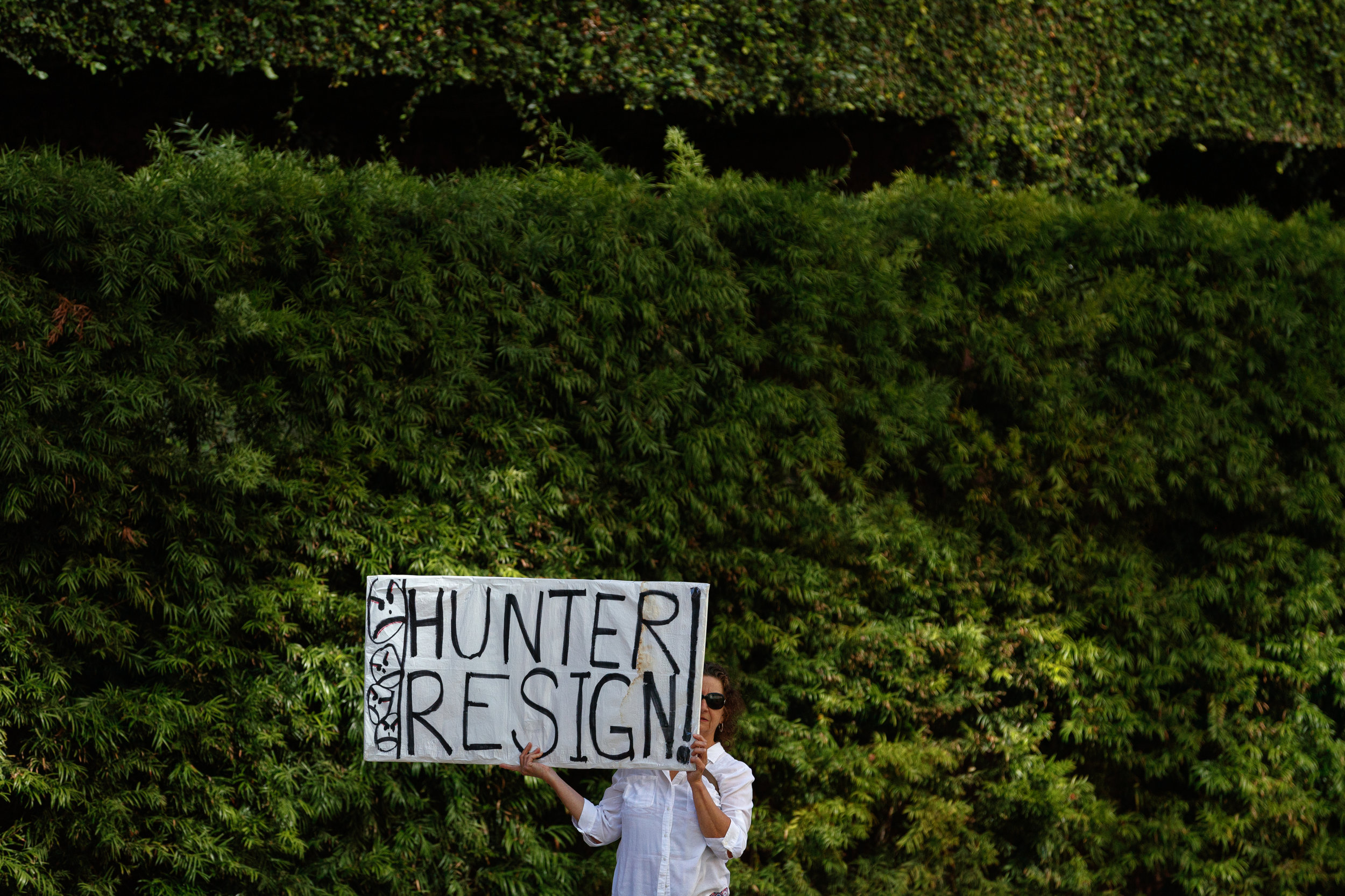 A protestor holds a sign outside the U.S. District Court for the Southern District of California while waiting for Rep. Duncan Hunter (R-CA) to arrive for a hearing on July 1, 2019 in San Diego, California. Hunter is facing a federal criminal trial for 60 felony charges that relate to spending campaign money on family vacations, bills, and personal expenses. Hunter's wife, Margaret, pleaded guilty to one count of felony conspiracy in June and is cooperating with prosecutors. A trial date is set for September 10, 2019.