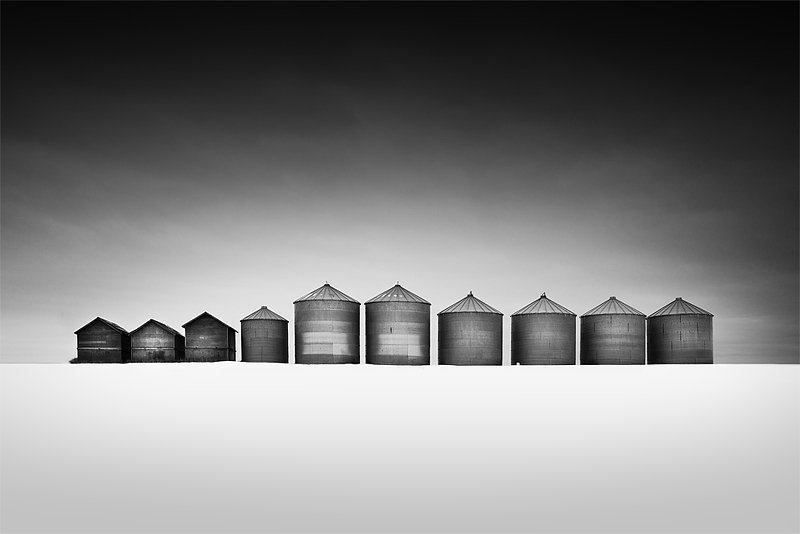 7 silos and 3 shacks in a snow covered pasture. © Olivier Du Tre