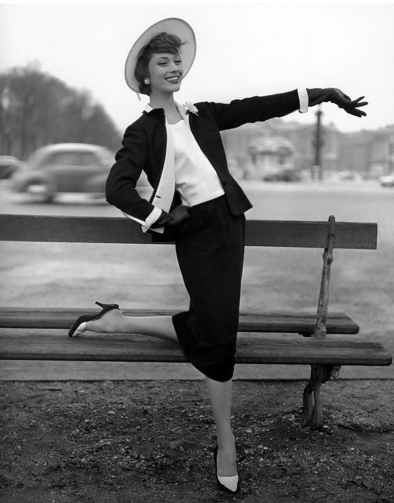 Marie-Hélène Arnaud in elegant black shantung and white piqué suit by  Chanel , photo by Georges Dambier, ELLE, February 11, 1957