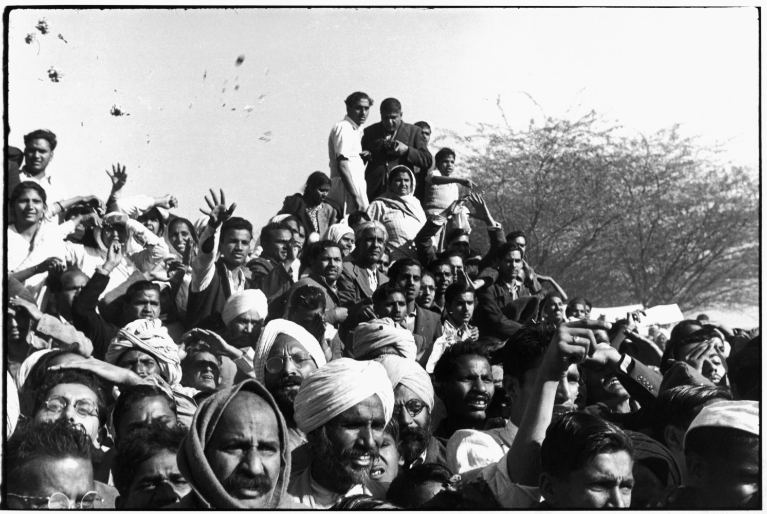 Crowds gathered between Birla House and the cremation grounds on the Jumna River, during Gandhi's funeral. Delhi, India. 1948. © Henri Cartier-Bresson | Magnum Photos