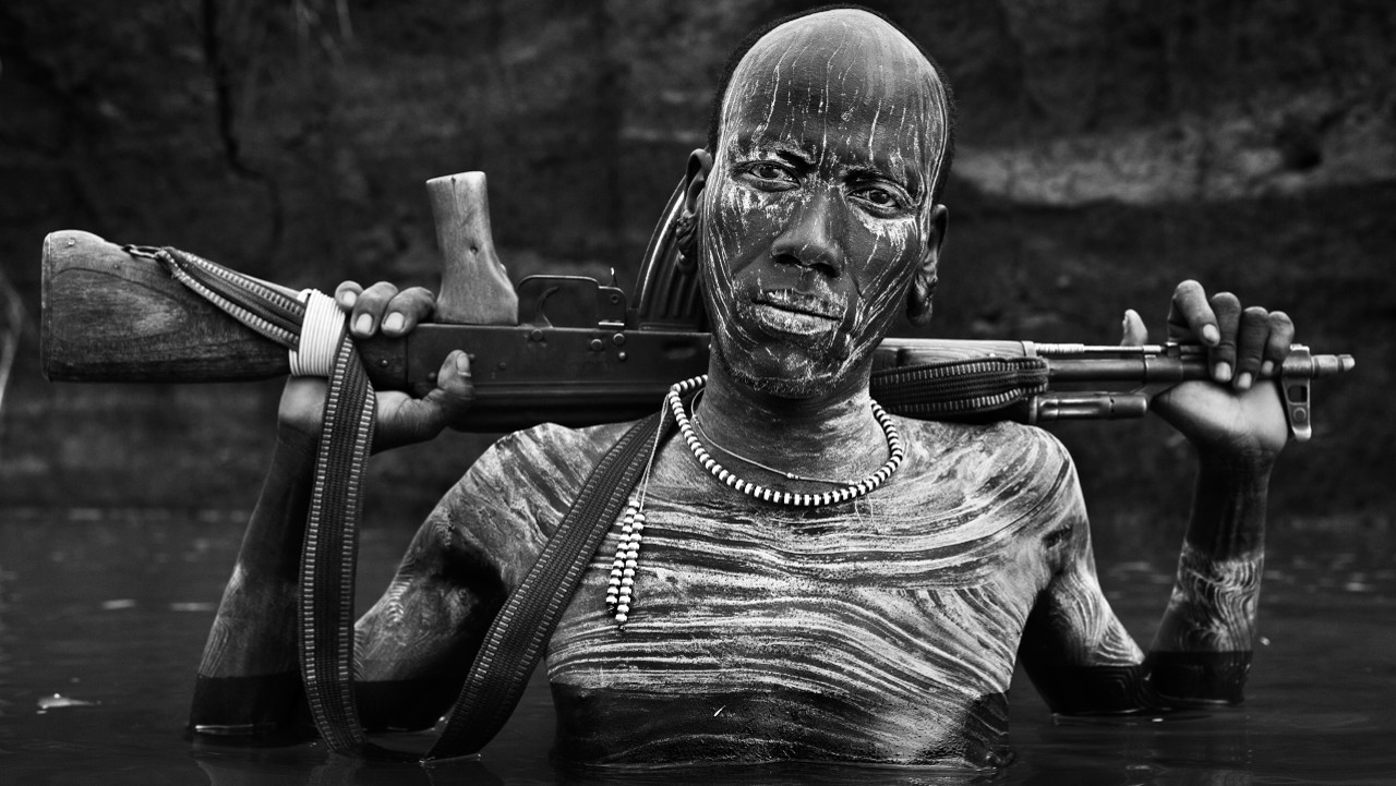 David Yarrow - Warrior Portrait, The Omo, Ethiopia, 2013.