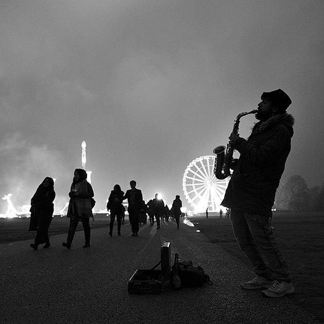 Joe McNally, Lone Sax Player at Night in London, Hyde Park, 2014
