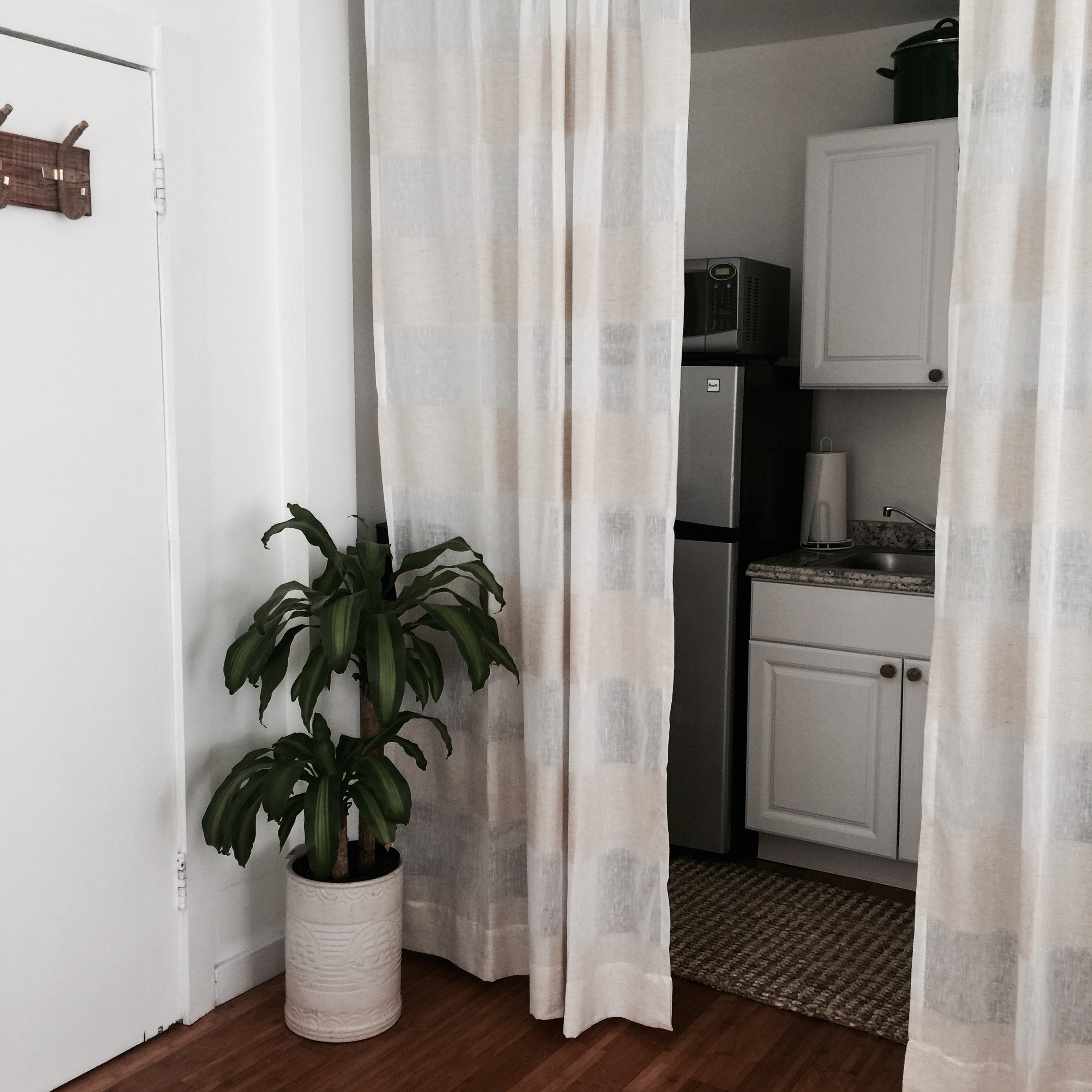 The kitchen is by the front door and there are curtains to cover the kitchen area if you like.