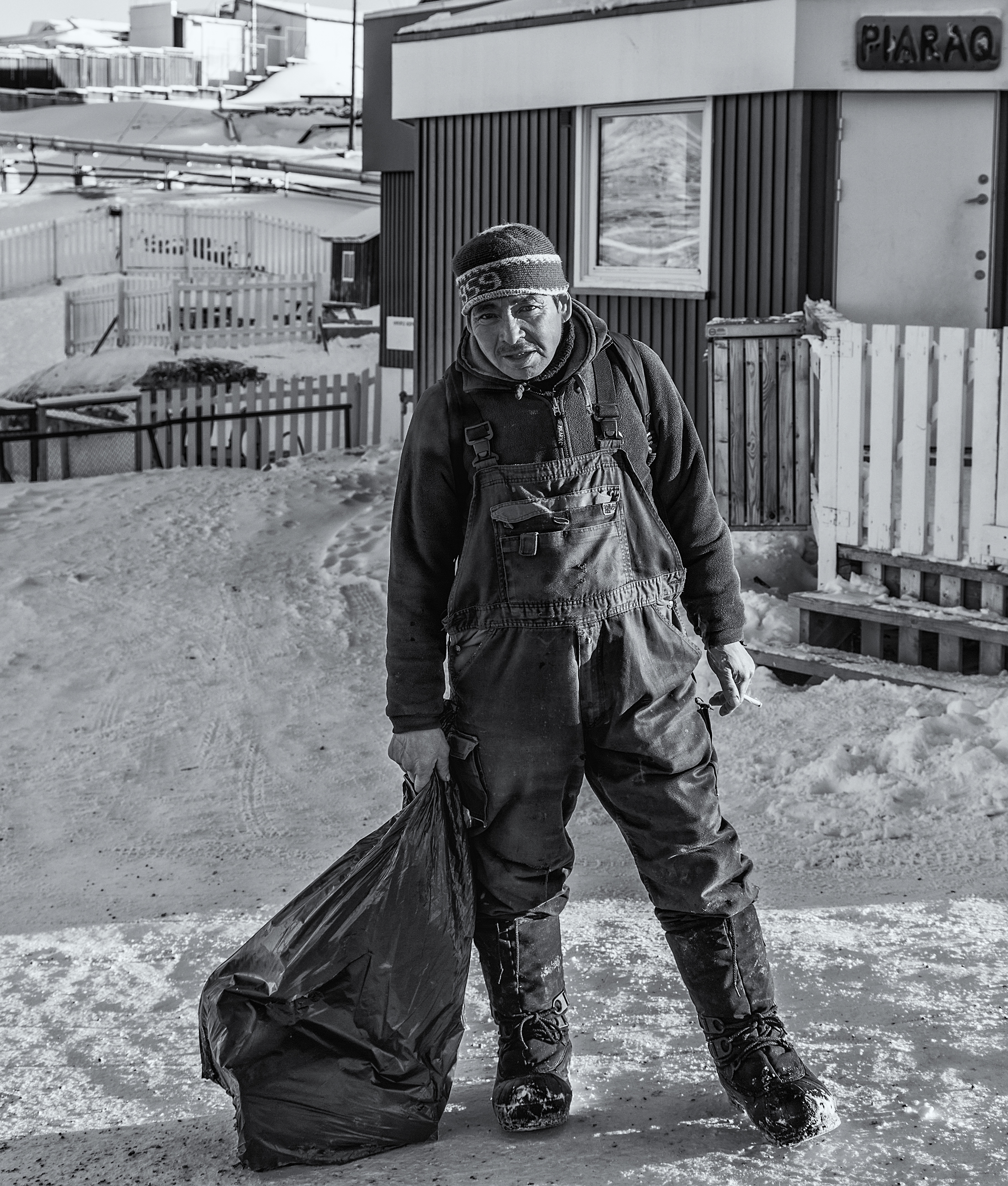 Local Ilulissat Greenlander with his groceries.
