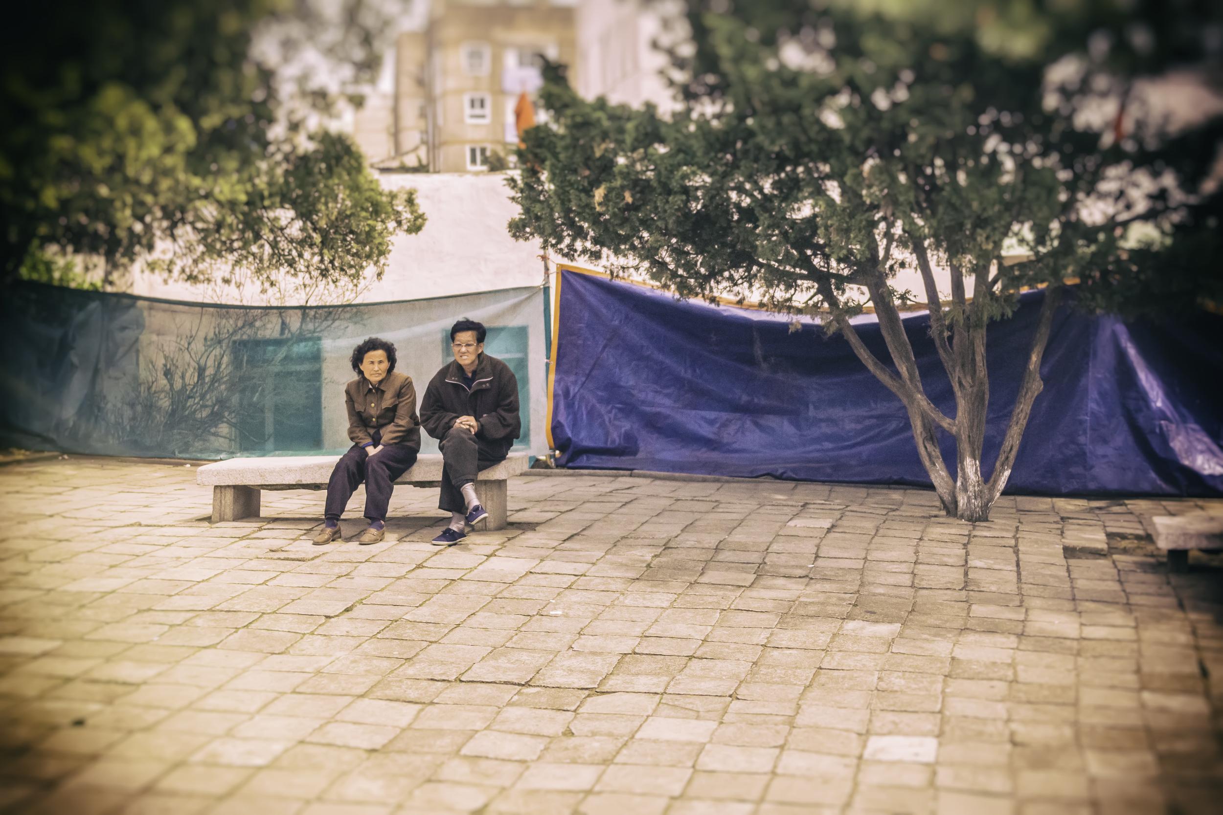 North Korean Couple On A Bench