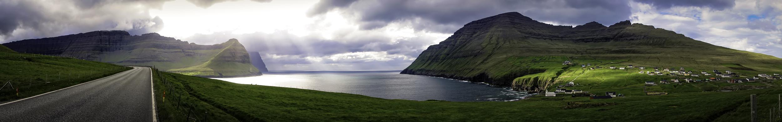 The village of Viðareiði receives a small sun bath.