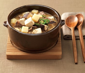 Doenjang Jjigae (Soybean Paste Stew)  - This stew-like Korean dish is made by boiling an assortment of ingredients such as meat, clams, vegetables, mushrooms, chili, tofu, and soy paste.