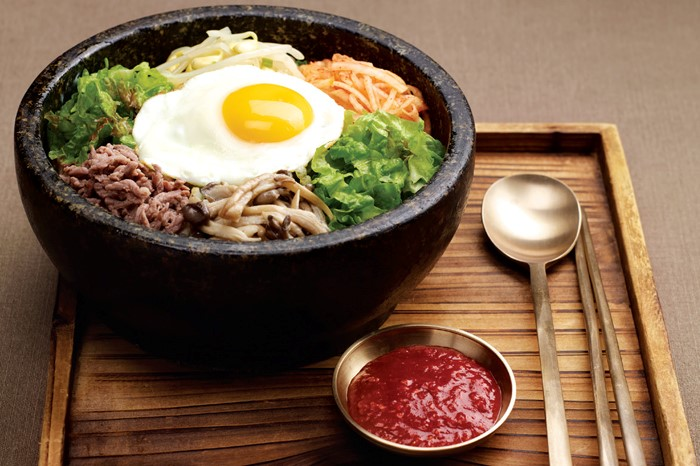 Bibimbap  - Cooked rice served with fresh and seasoned vegetables, minced beef and chili paste.