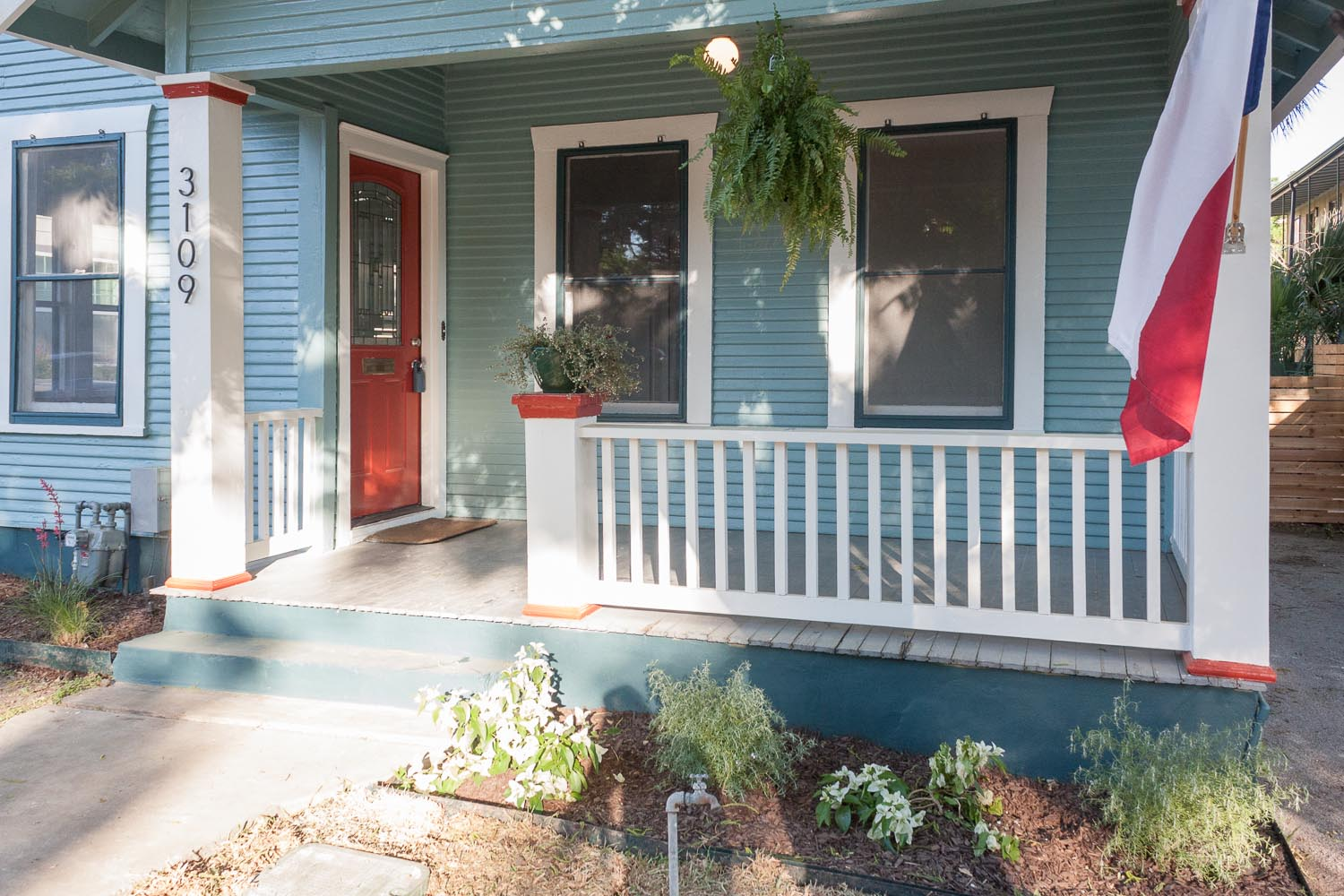 Austin Bungalow Hyde Park front porch with flag and fern and 5 color paint scheme.
