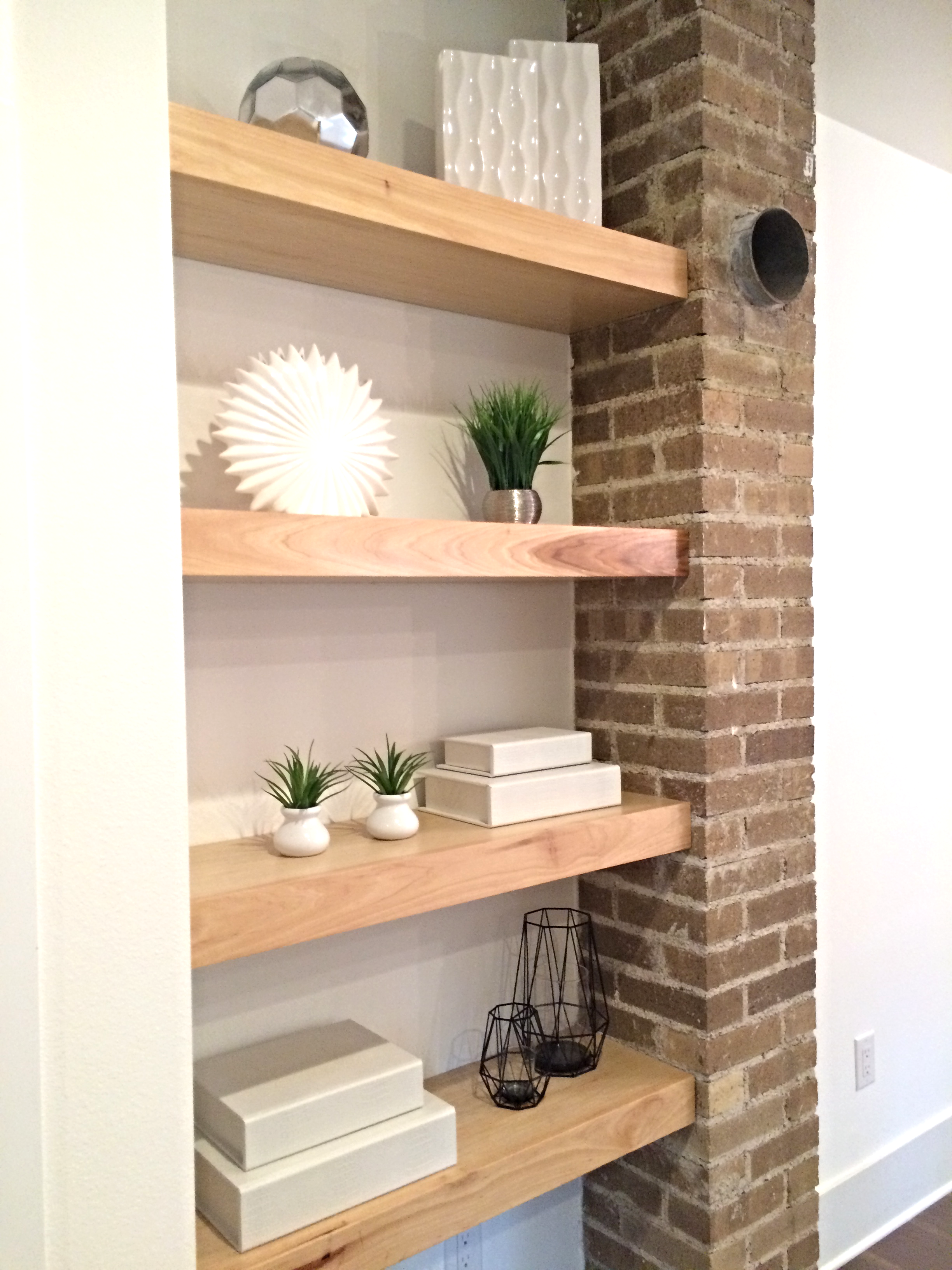 New local hardwood Pecan floating shelves next to old 1930s brick chimney original to the bungalow!