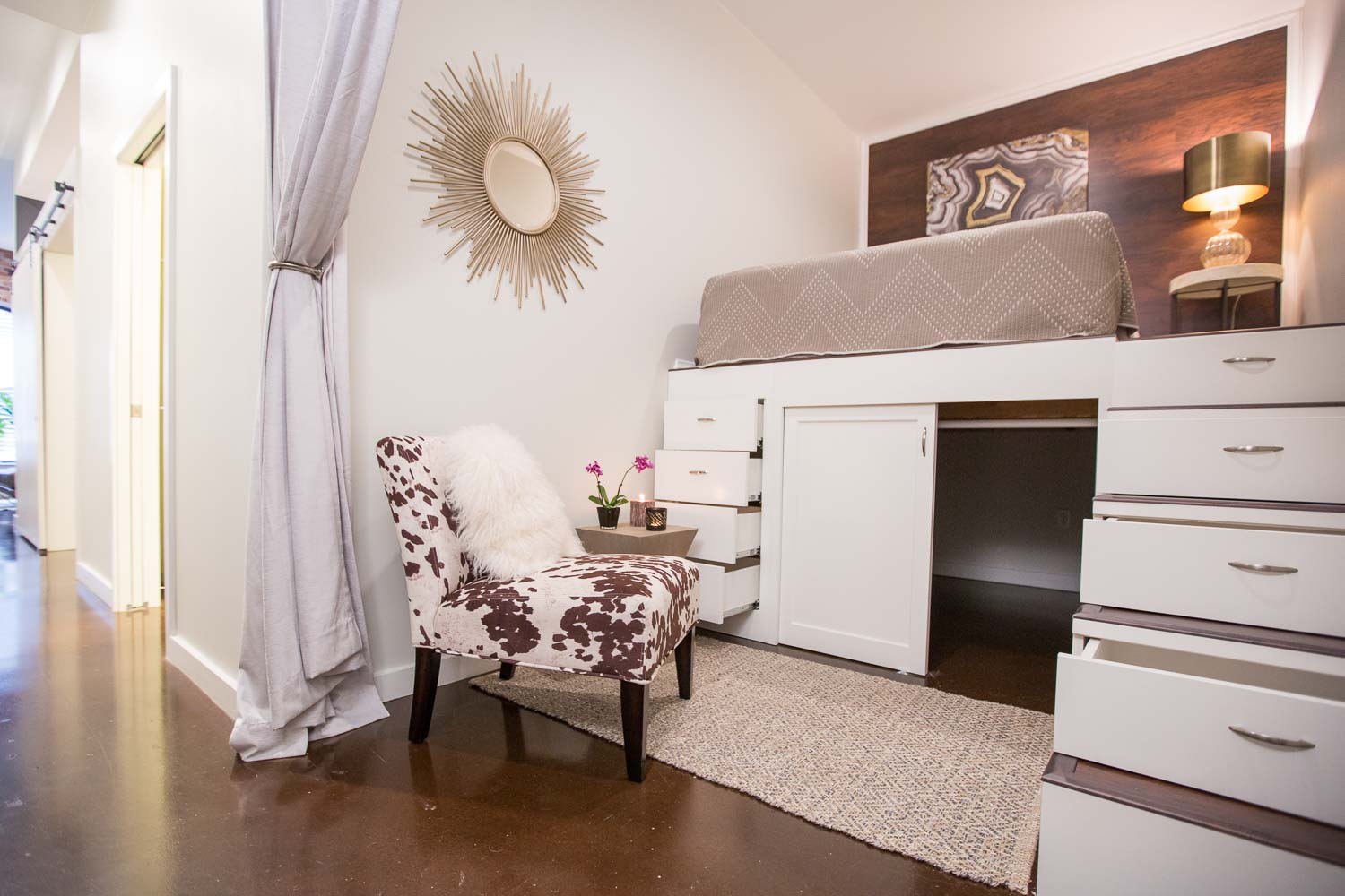 The investor/clients had the great idea to add a lofted guest room with wood paneled headboard wall and plenty of storage. They implemented and we added the cowhide chair and detailing.